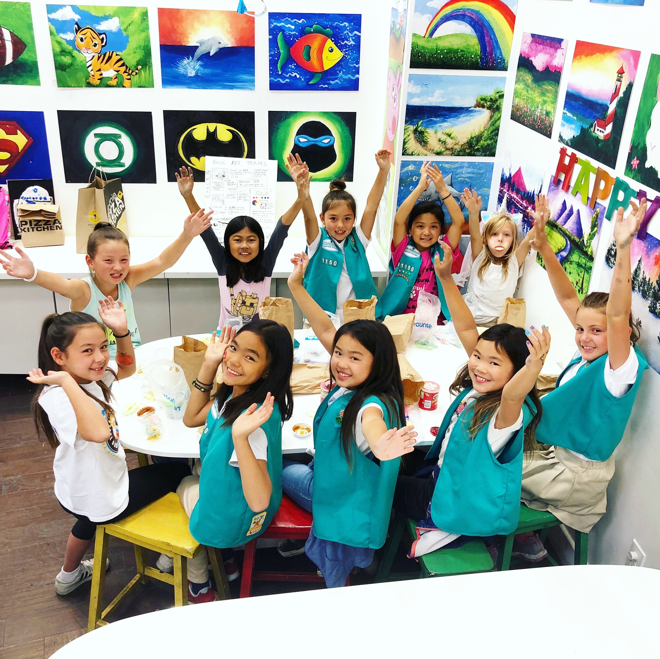 girl scouts celebrating during an art lesson.JPG