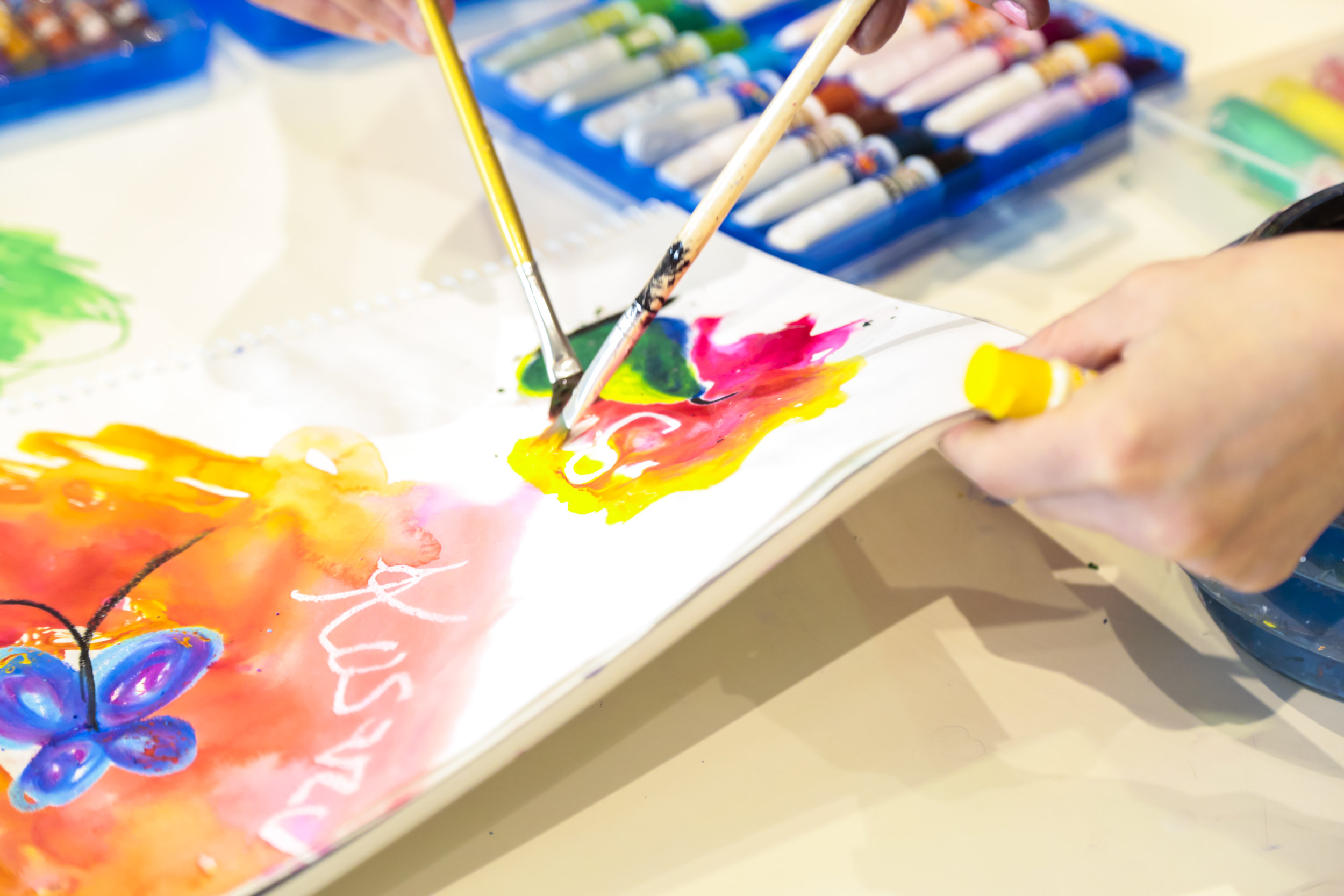 image of hand painting the background of a drawing.JPG