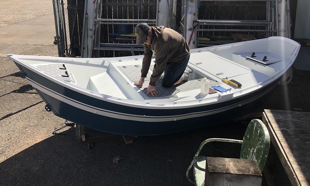Peter installing SeaDek