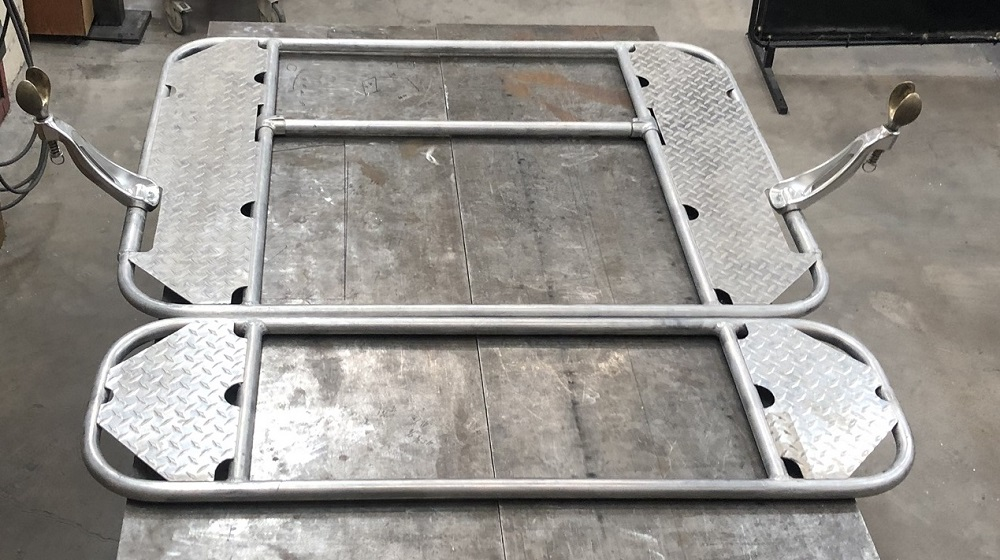 Two-part raft frame with diamond plate decks.