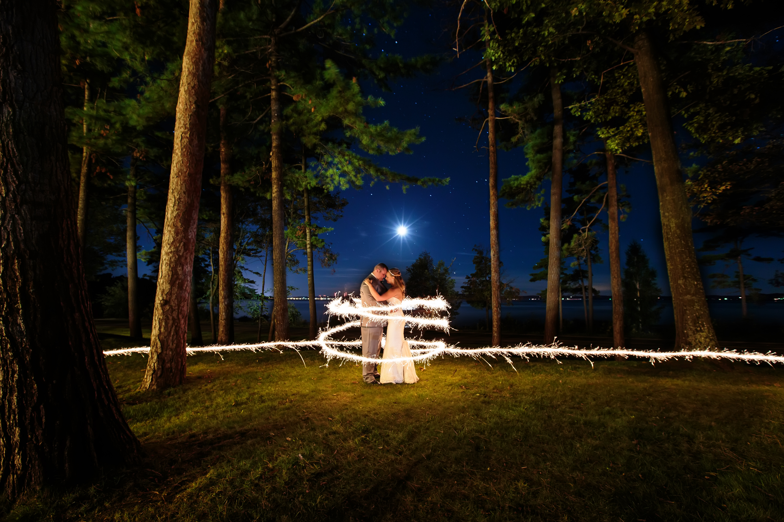 Bride and groom at night with full moon and sparkler at bowers harbor | Rayan Anastor Photography | Traverse City Wedding Photographer.jpg