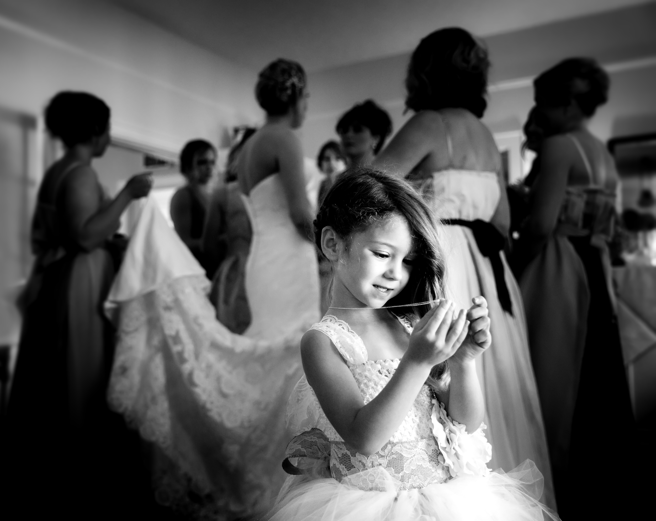 Flower girl smiling at locket before wedding | Rayan Anastor Photography | Traverse City Wedding Photographer.jpg