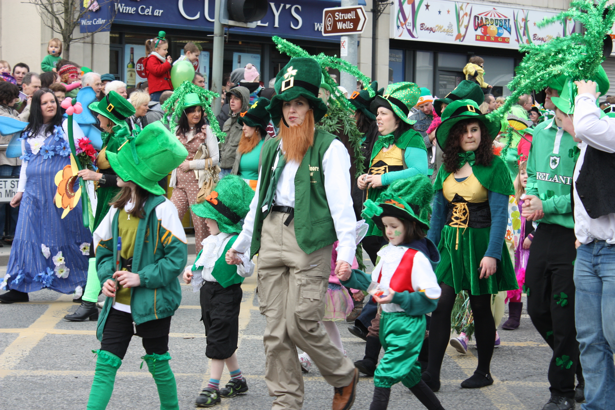 """ St Patricks Day, Downpatrick, March 2011 "" by  Ardfern  is licensed under  CC BY-SA 3.0 ."