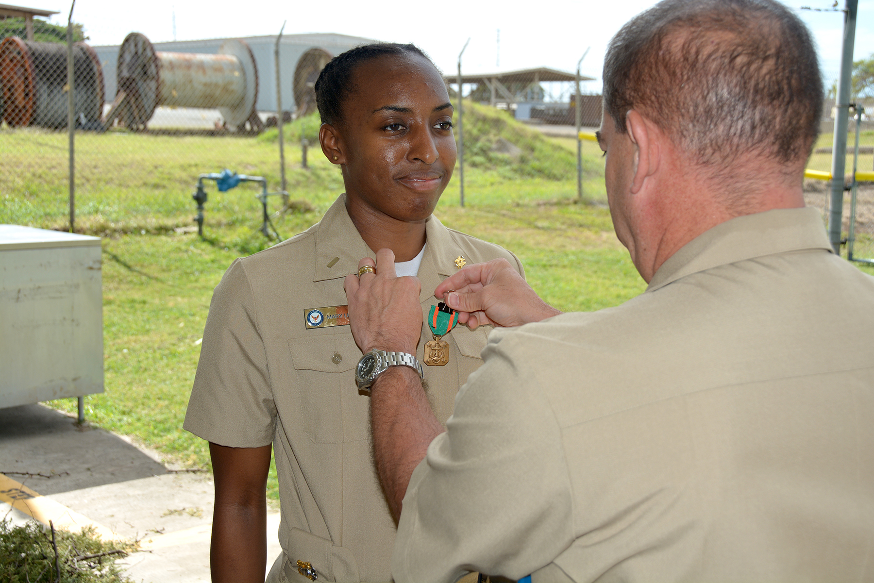 """U.S. Navy Photo """" Navy and Marine Corps Achievement Medal - Leone """" by  Denise Emsley ,  NAVFAC Hawaii , Public Affairs/Released is licensed under  CC BY 2.0 ."""