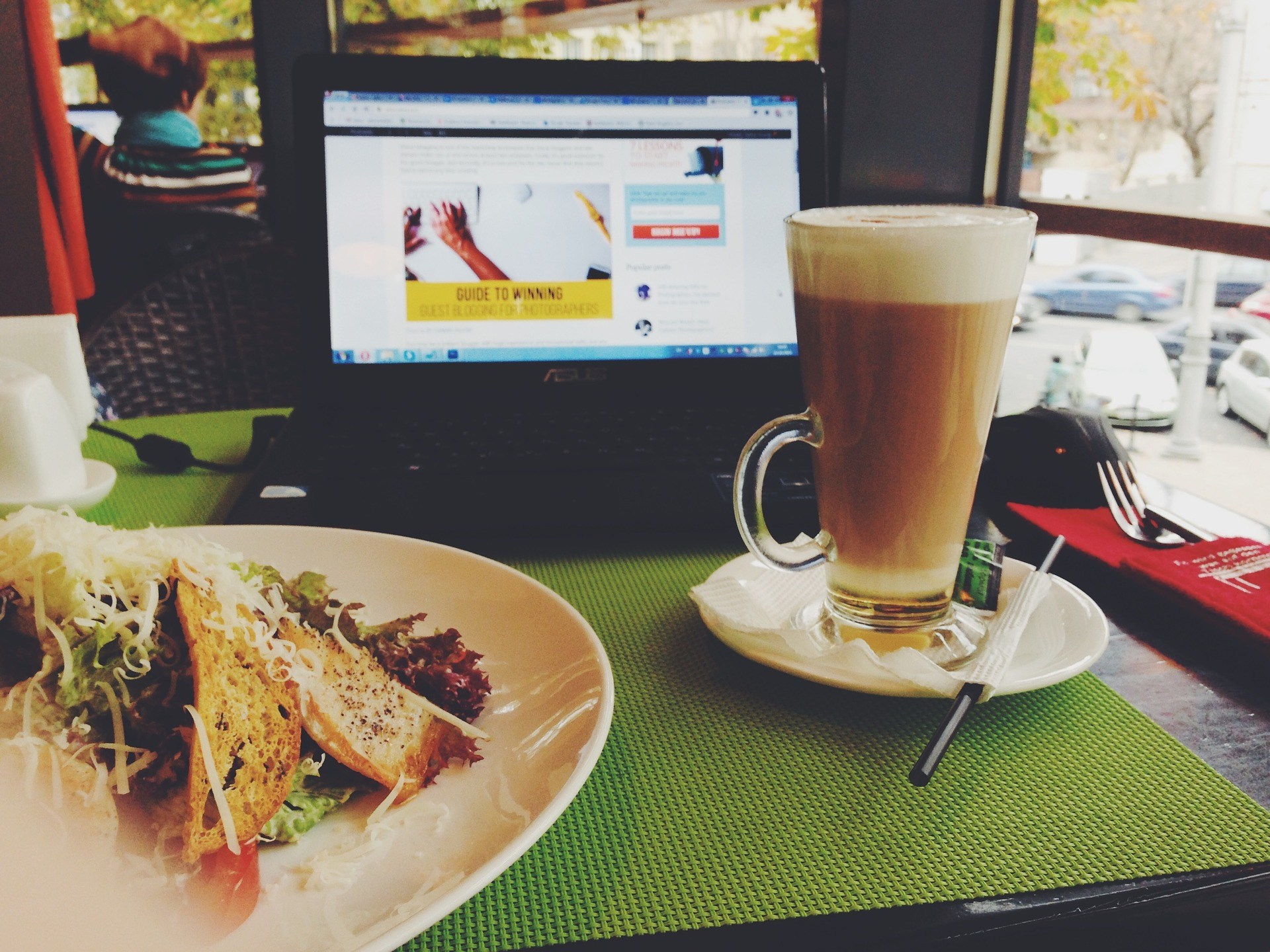 """ Cafe, Lunch, Coffee, Laptop, Food, Latte "" by  StockSnap  is  public domain ."