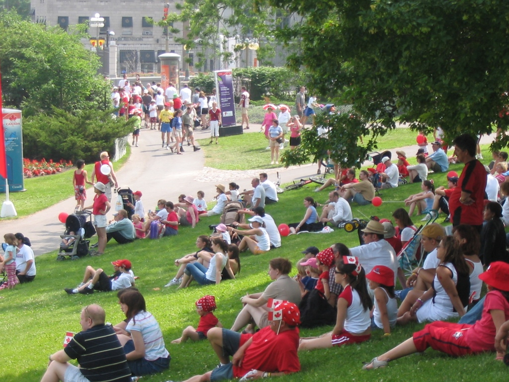 """ Canada Day Crowd "" by  Jawaad Mahmood  is licensed under  CC BY 2.0 ."