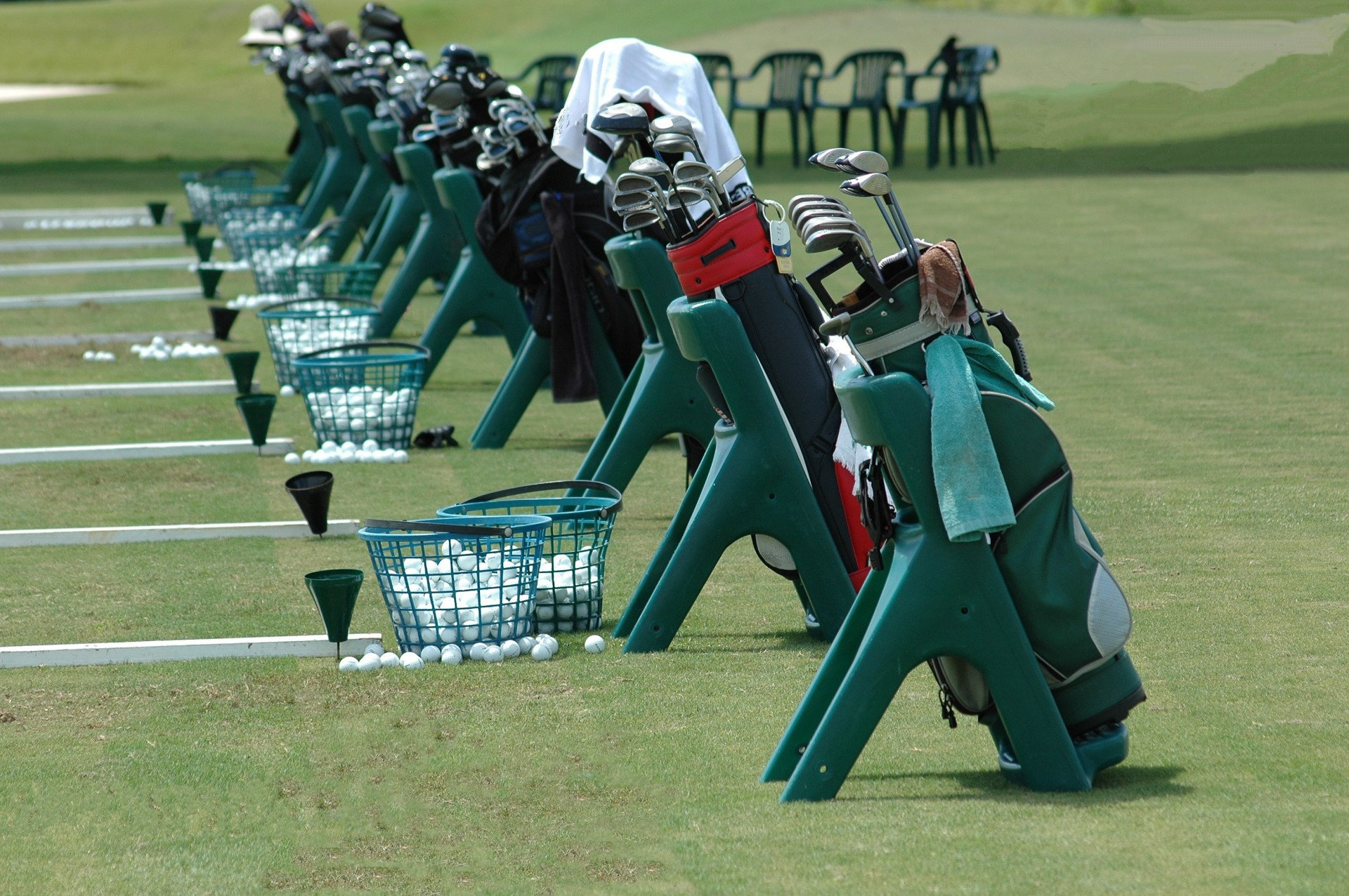 Golf Bags Lined Up  by  Paul Brennan  is  public domain .