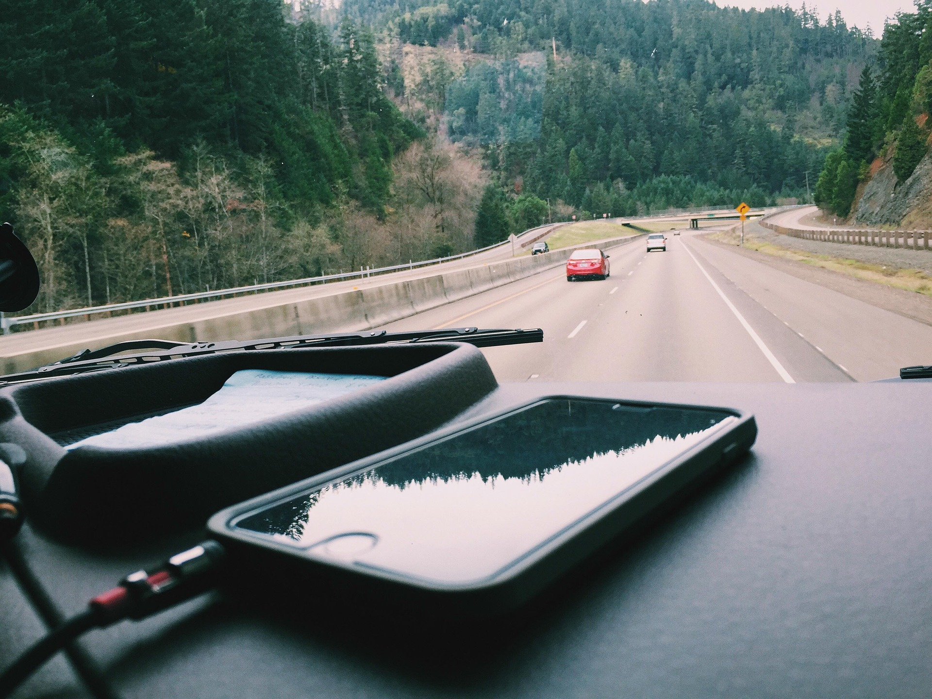 """"""" iPhone, car, dashboard, driving, cell """" by  StockSnap  is  Public Domain ."""