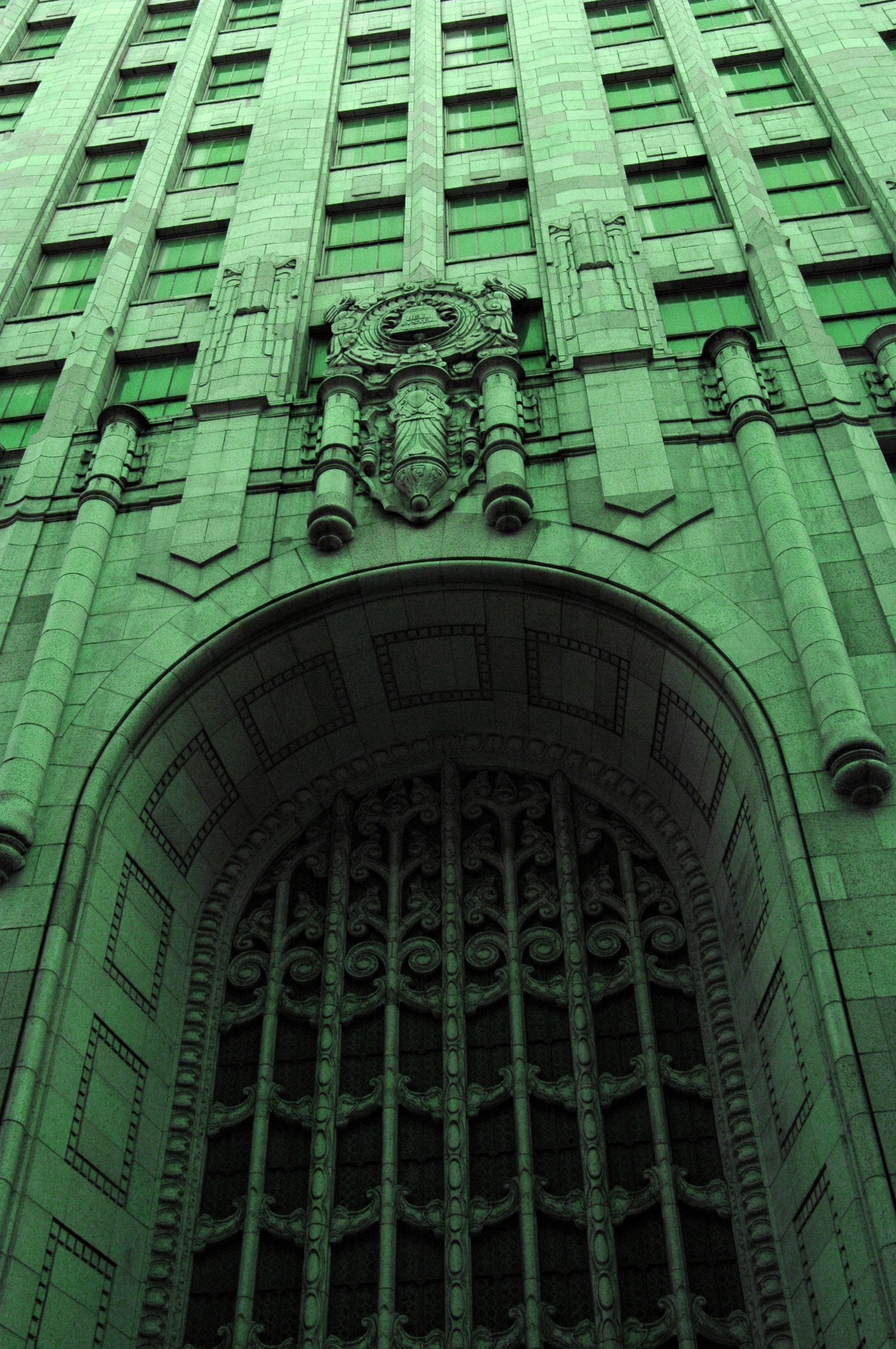 """ Going Green, The Ma Bell Building, art deco archway and details "" by  Wonderland  is licensed under  CC BY 2.0 ."