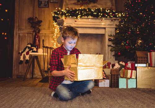 Depositphotos_132496206_s-2015 boy opening xmas gift.jpg