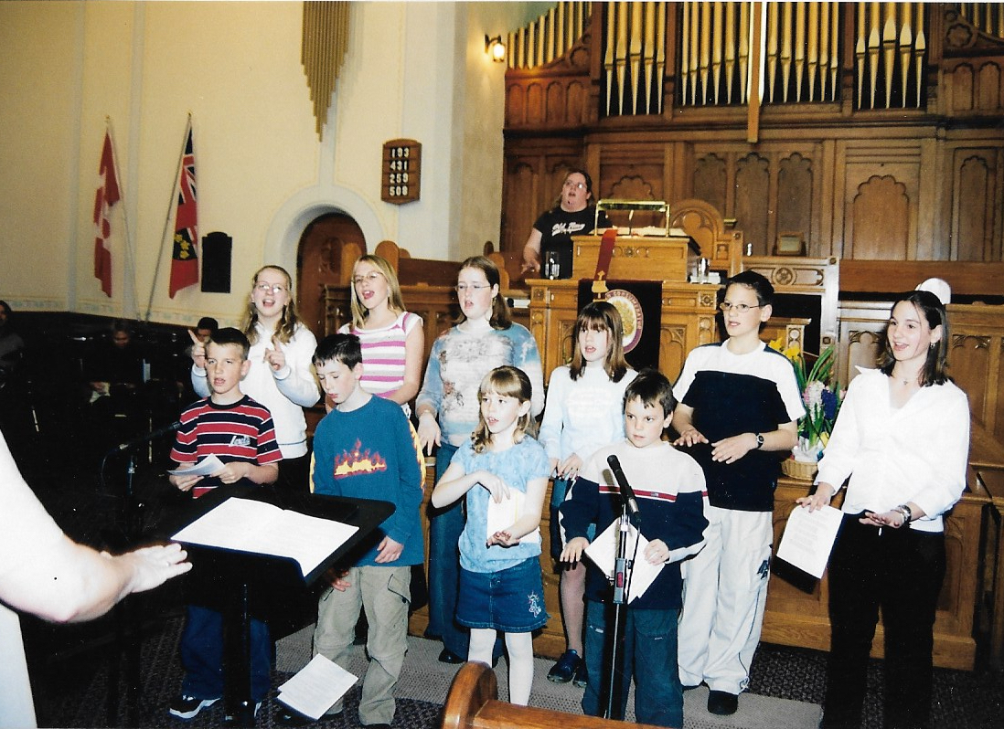 Junior Choir April 4, 2004 (singing) Back Row L-R:  Lauren Johns, Karlie Purcell, Terri Brown, Torie Clarke, Michael Lockie, Alicia Lockie  Front Row L-R:  Ethan Purcell, Christopher Hamilton, Kathleen Skinner, Paul Lockie