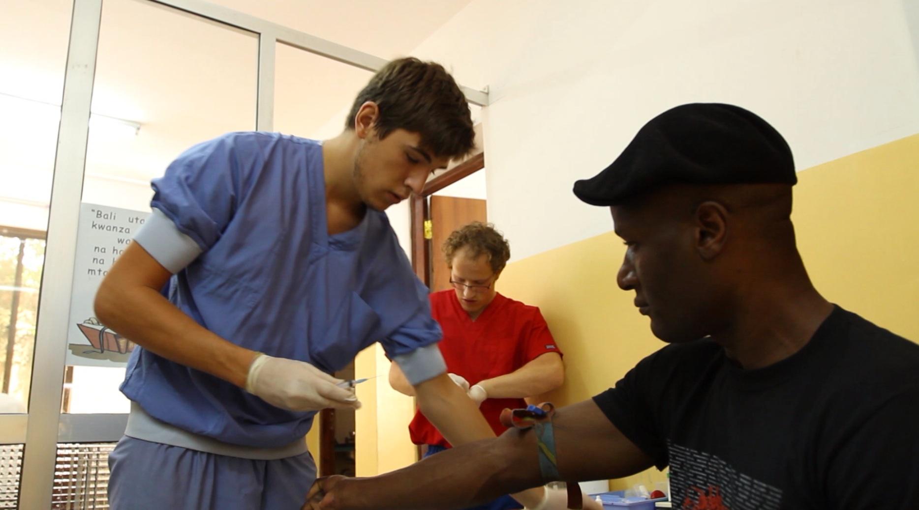 Matt attends to a patient
