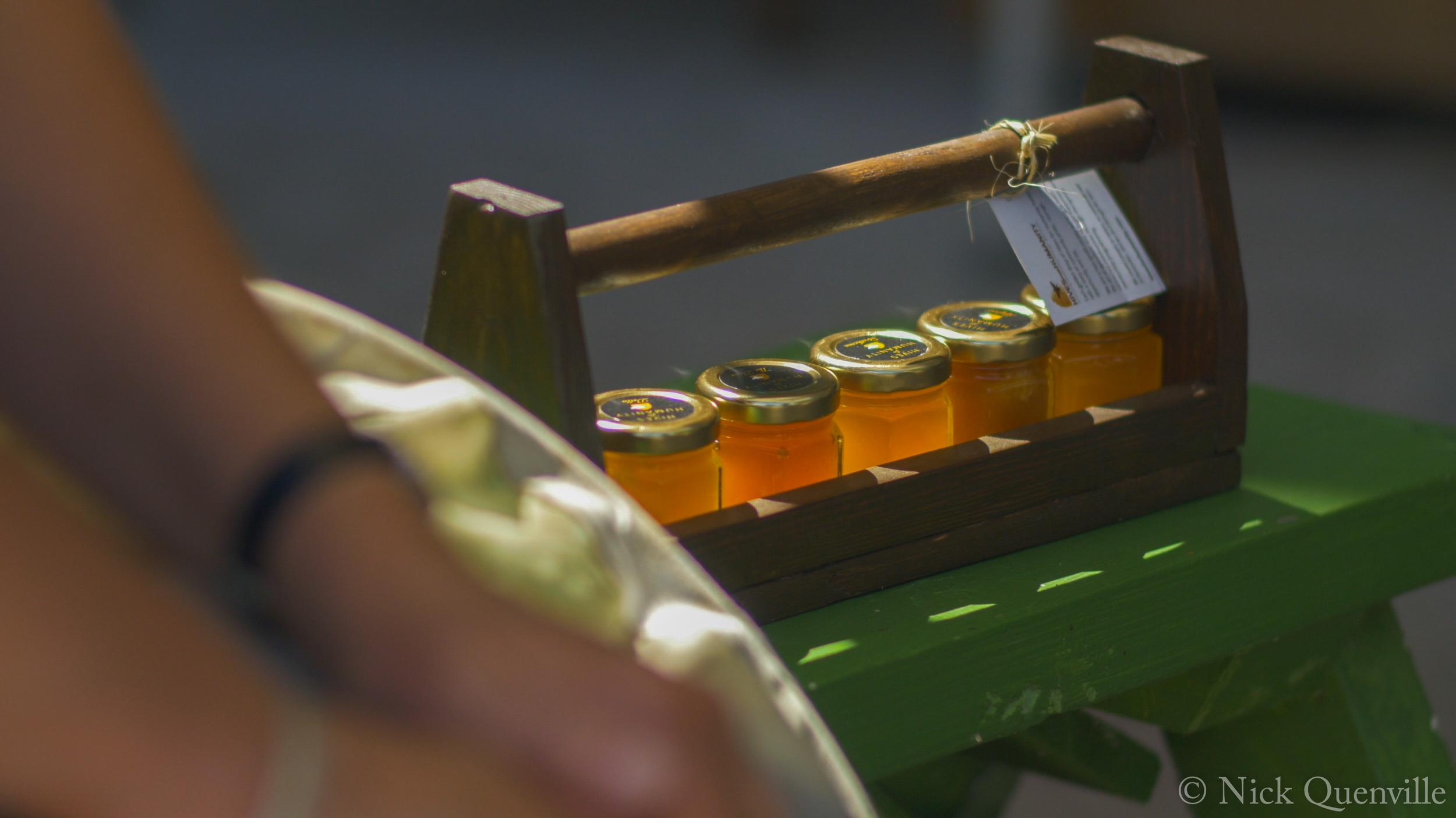 Row of Honey Jars Outside.jpg