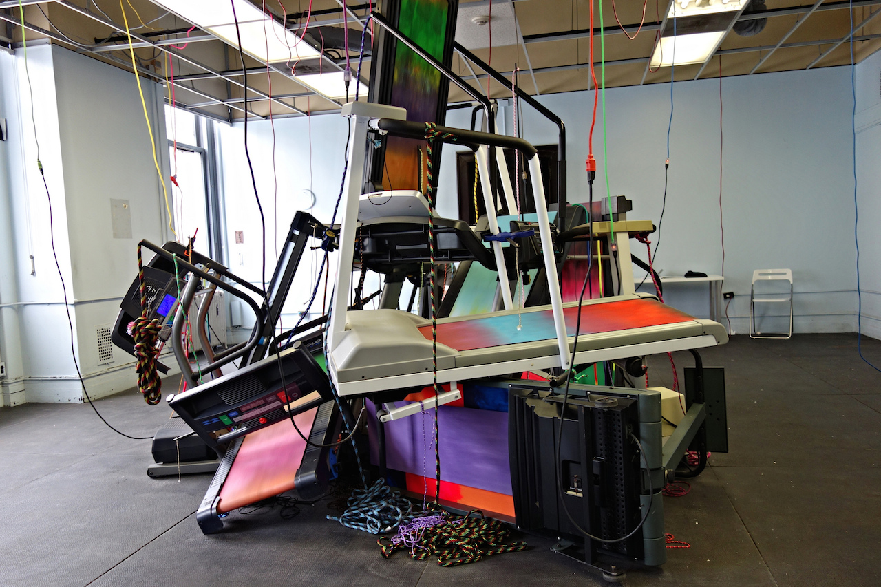Brent Birnbaum's installation of painted treadmills, curated by Elizabeth Denny & Craig Poor orgonteith at the 2015 Spring/Break Art Show (all photos by the author for Hyperallergic)