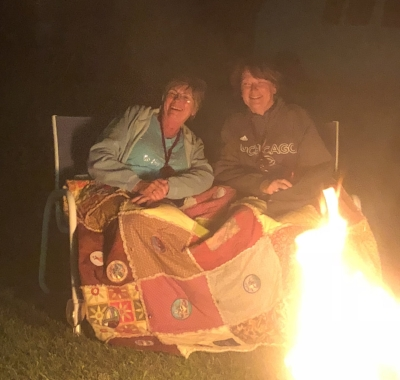 Notice the patches being displayed on this fireside cozy quilt?