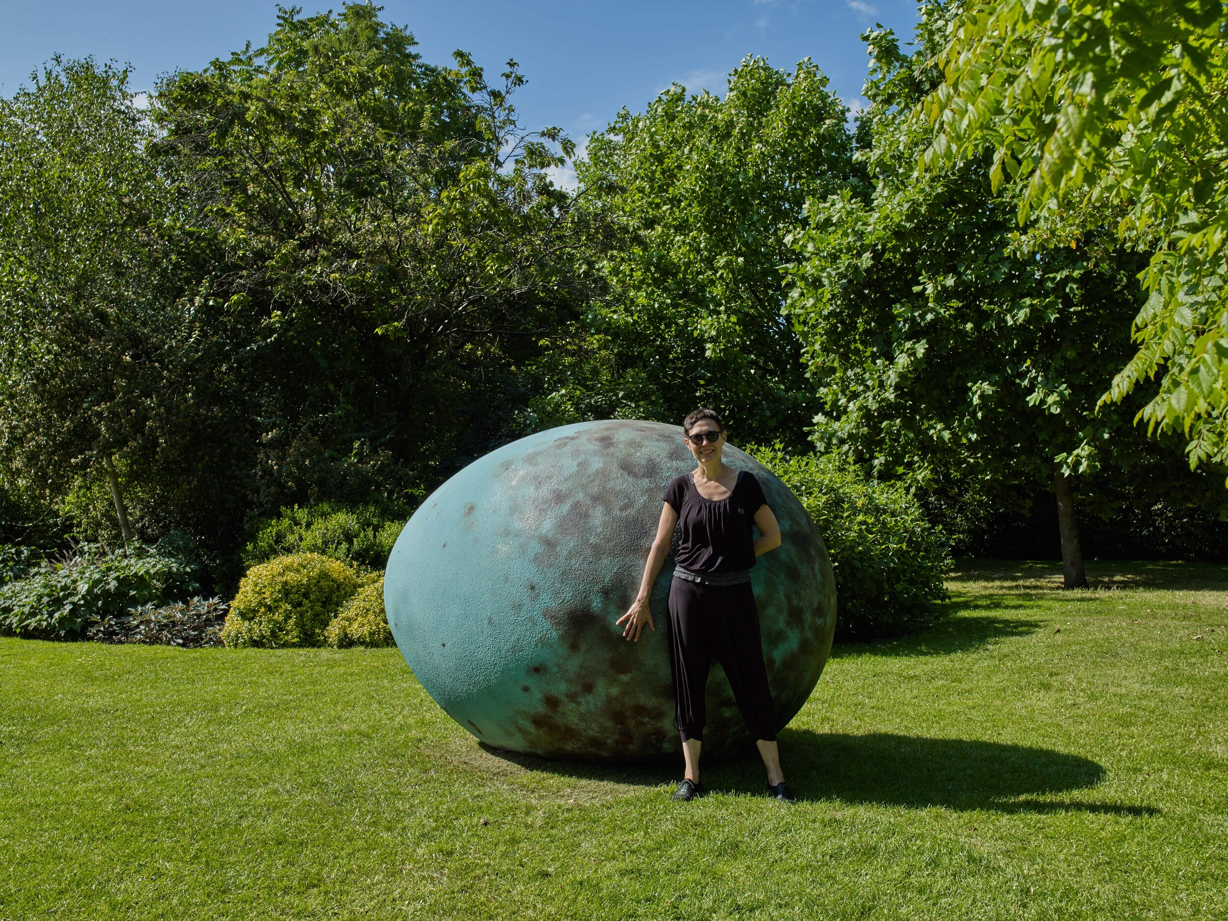 Joanna Rajkowska in front of The Hatchling at Frieze Sculpture