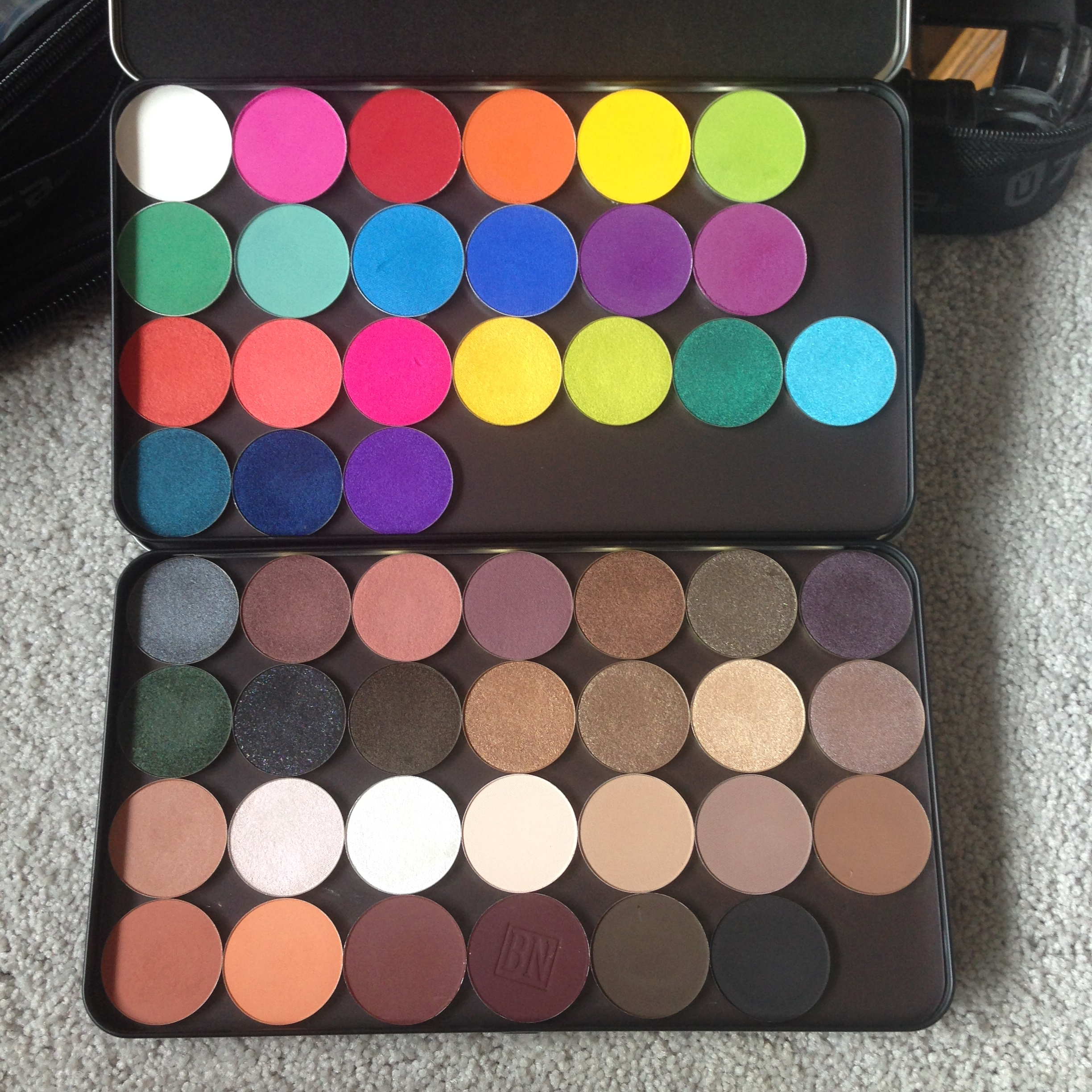 2 of my MUFE XL palettes. These hold28 MUFE eyeshadows (New and old formula) without the insert