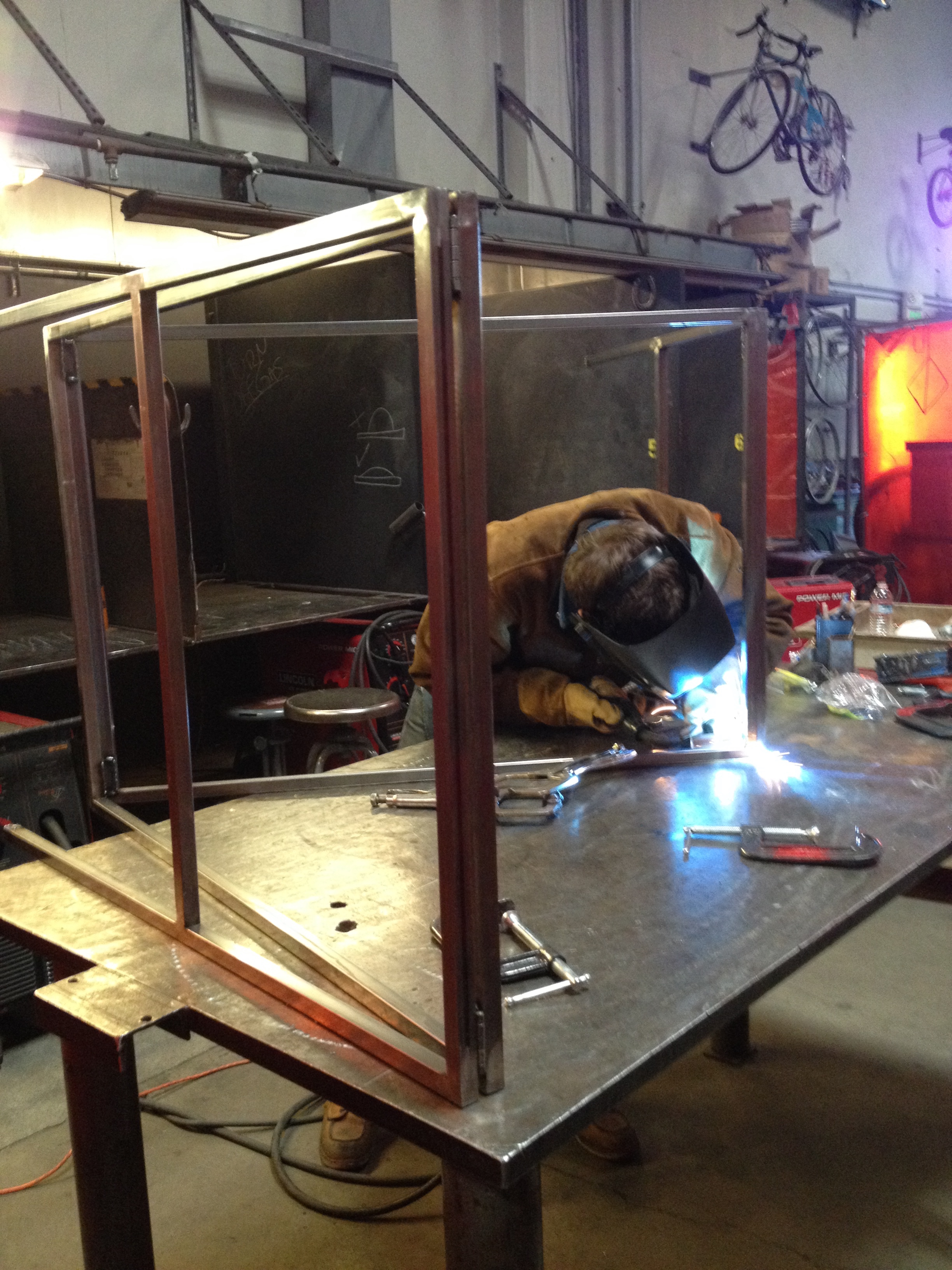 With the four frames completed, the next step was welding them together with the hinges.