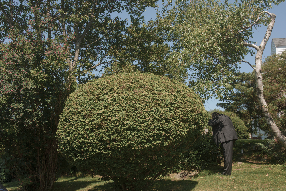 A supporter finished his food in the bushes before a private house function for invited Republicans on the coast.