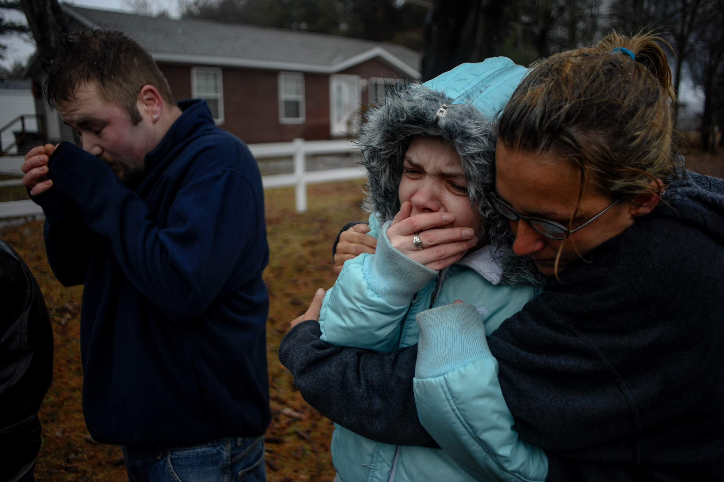 Debra Wallace is comforted by her friend Patti Linton during a fire at the Lee Township home of her ex-husband, Troy Faylor, that took the life of Jasmine Faylor, 3, their daughter. Midland County Sheriff Jerry Nielsen notified Wallace that her daughter had passed away.