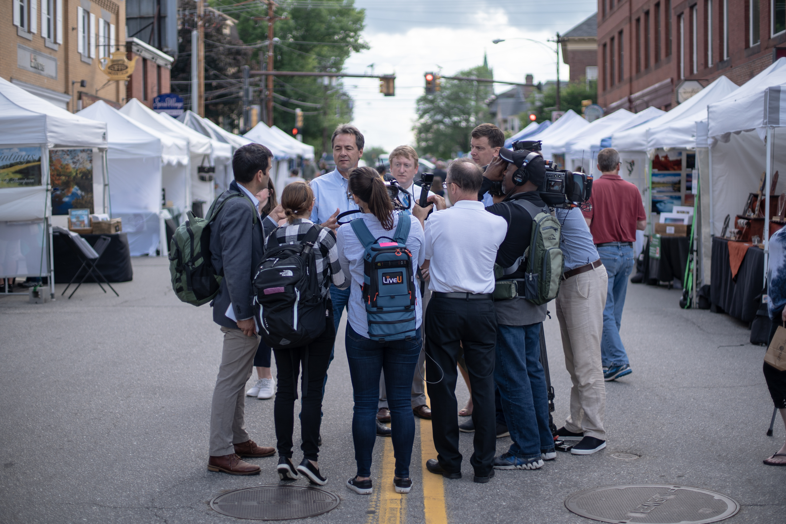 Gov. Steve Bullock of Montana walked through Market Days in Concord, New Hampshire on Friday, June 21, 2019. The stop was one of several over two days during Bullock's first visit to the state as a presidential candidate. 