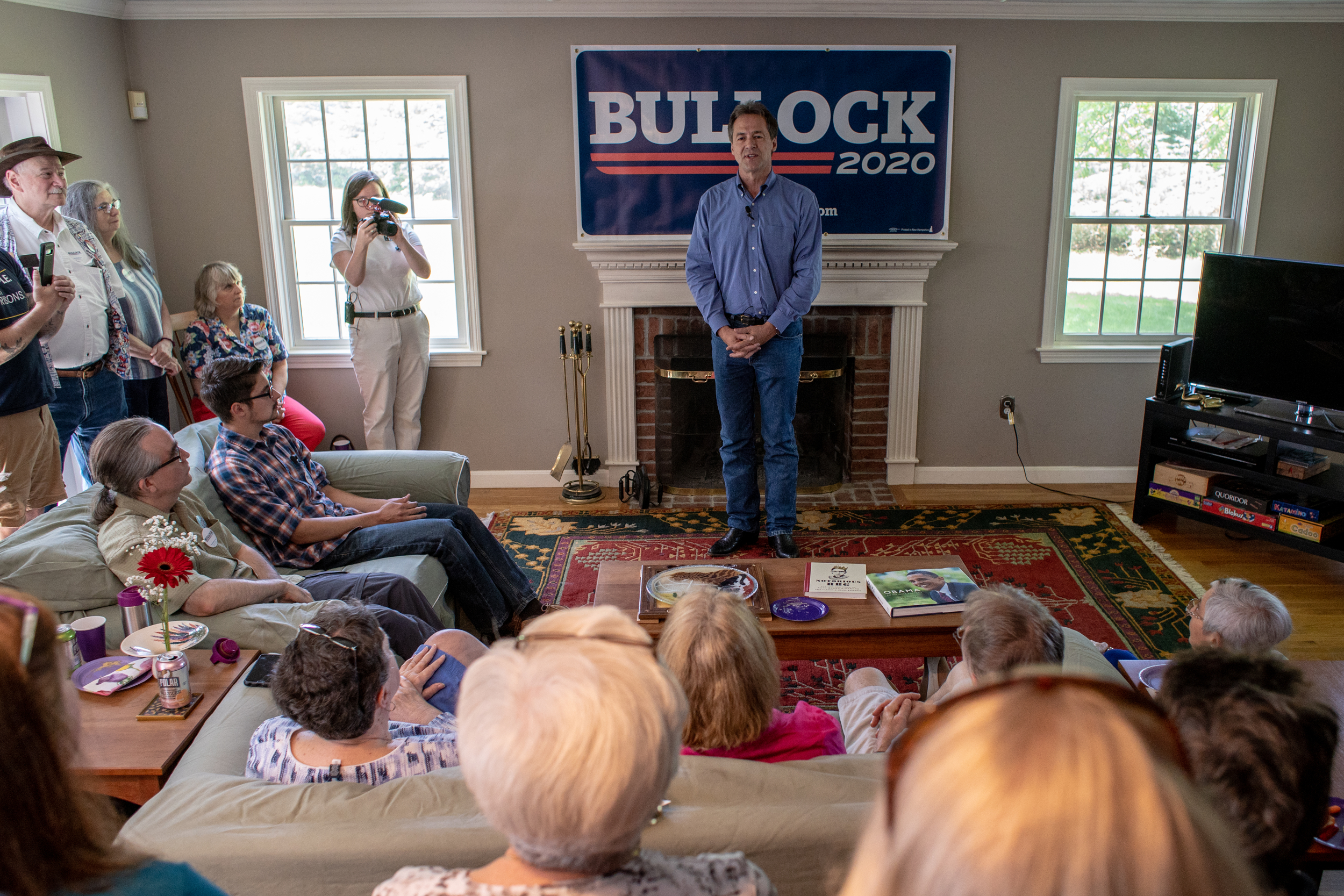 Gov. Steve Bullock of Montana speaks at a house party in Nashua, New Hampshire hosted by Joe Foster and Marissa Baltus on Saturday, June 22, 2019. The stop was one of several over two days during Bullock's first visit to the state as a presidential candidate. 