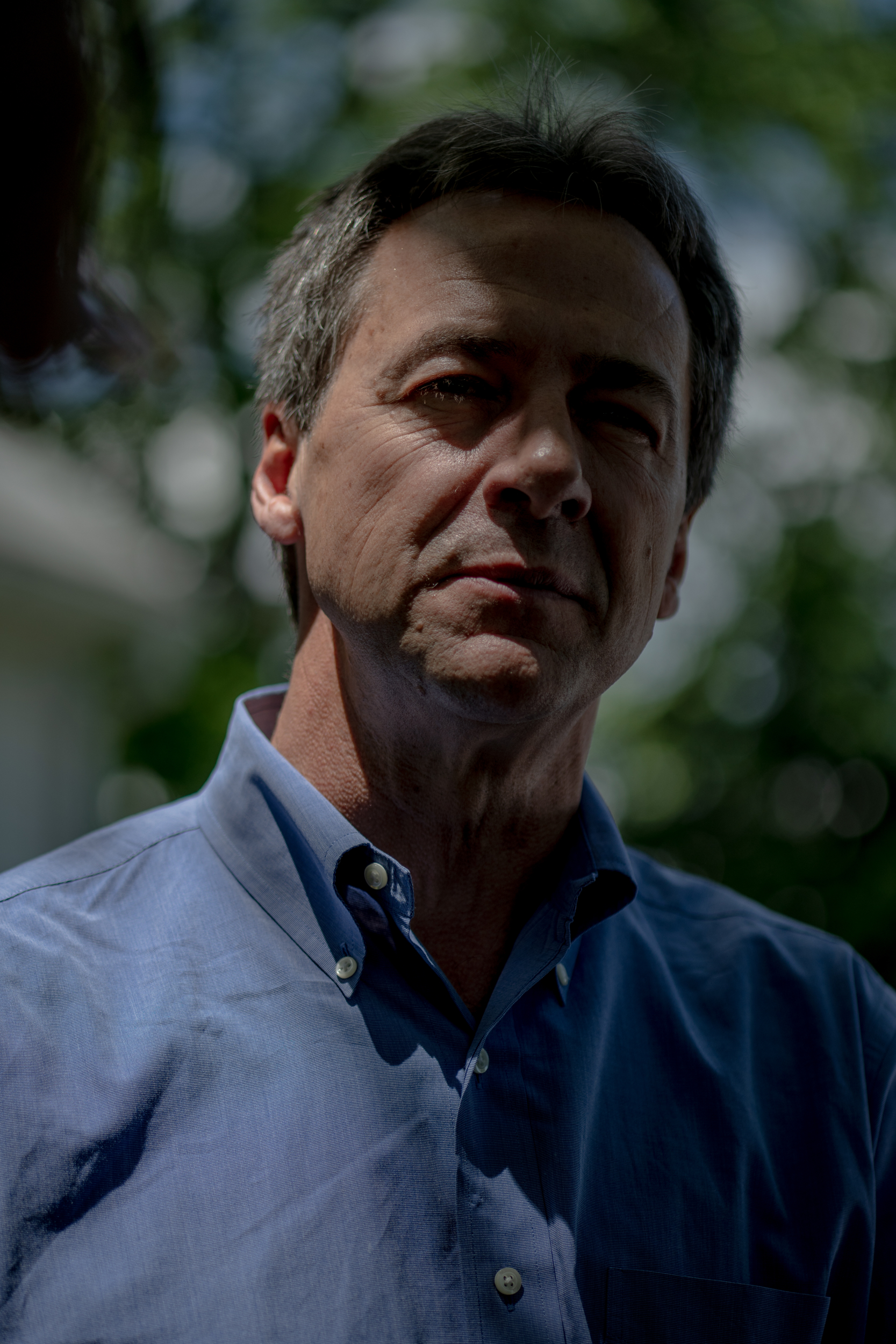 Gov. Steve Bullock of Montana speaks with the press following a house party in Nashua, New Hampshire hosted by Joe Foster and Marissa Baltus on Saturday, June 22, 2019. The stop was one of several over two days during Bullock's first visit to the state as a presidential candidate. 
