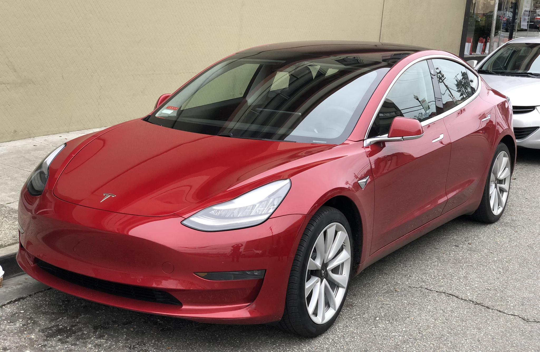Tesla_Model_3_parked,_front_driver_side.jpg