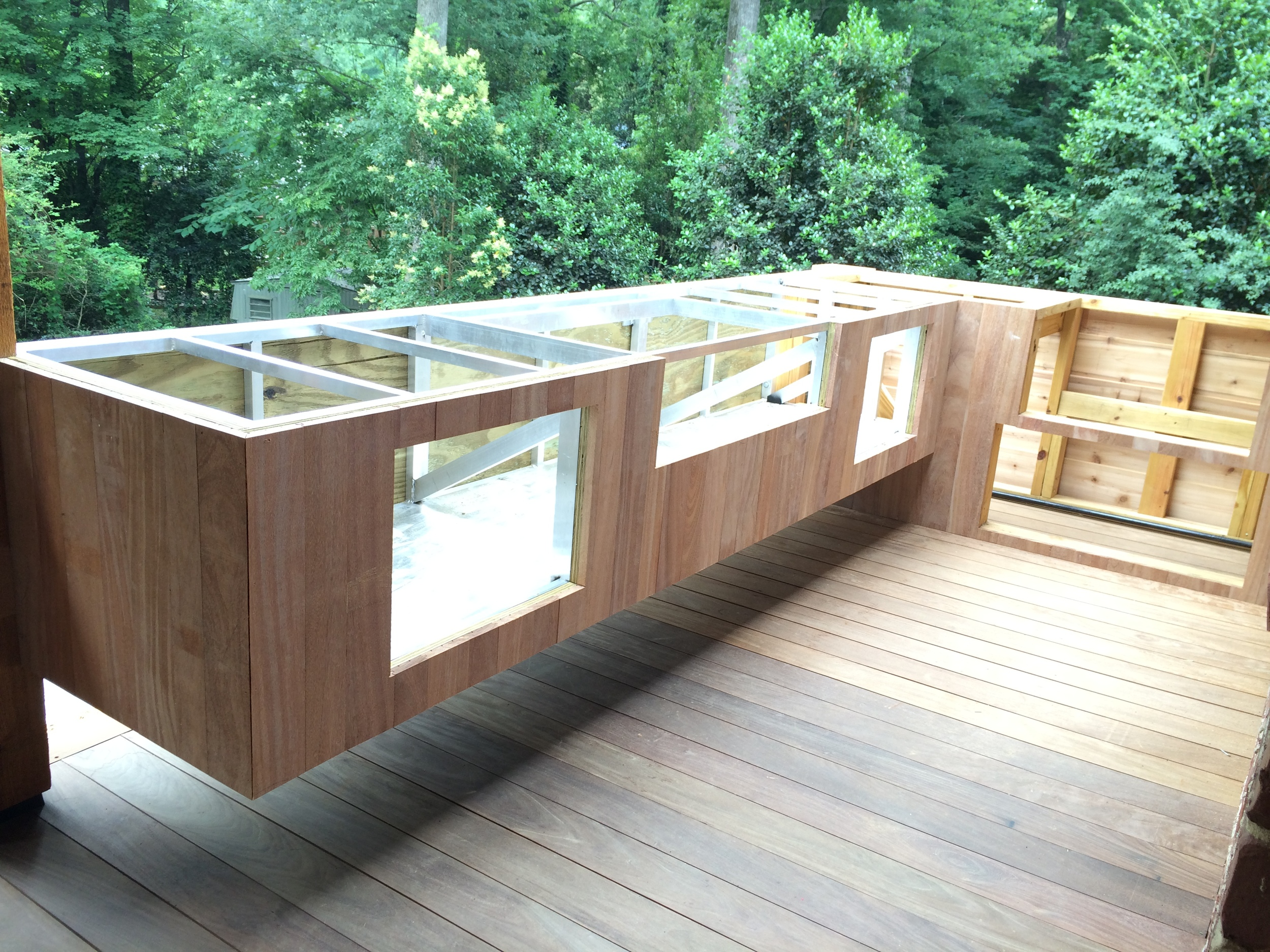 Outdoor floating kitchen with delta heat grill and big green egg