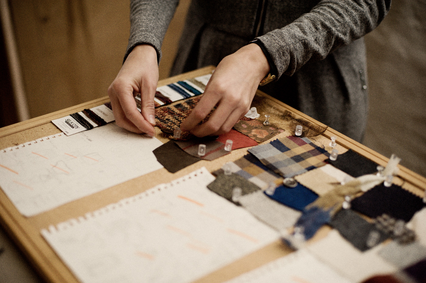 Tara St. James of StudyNY creates a swatch board for her season's collection.  Photography by Shawn Brackbill for Source4Style.