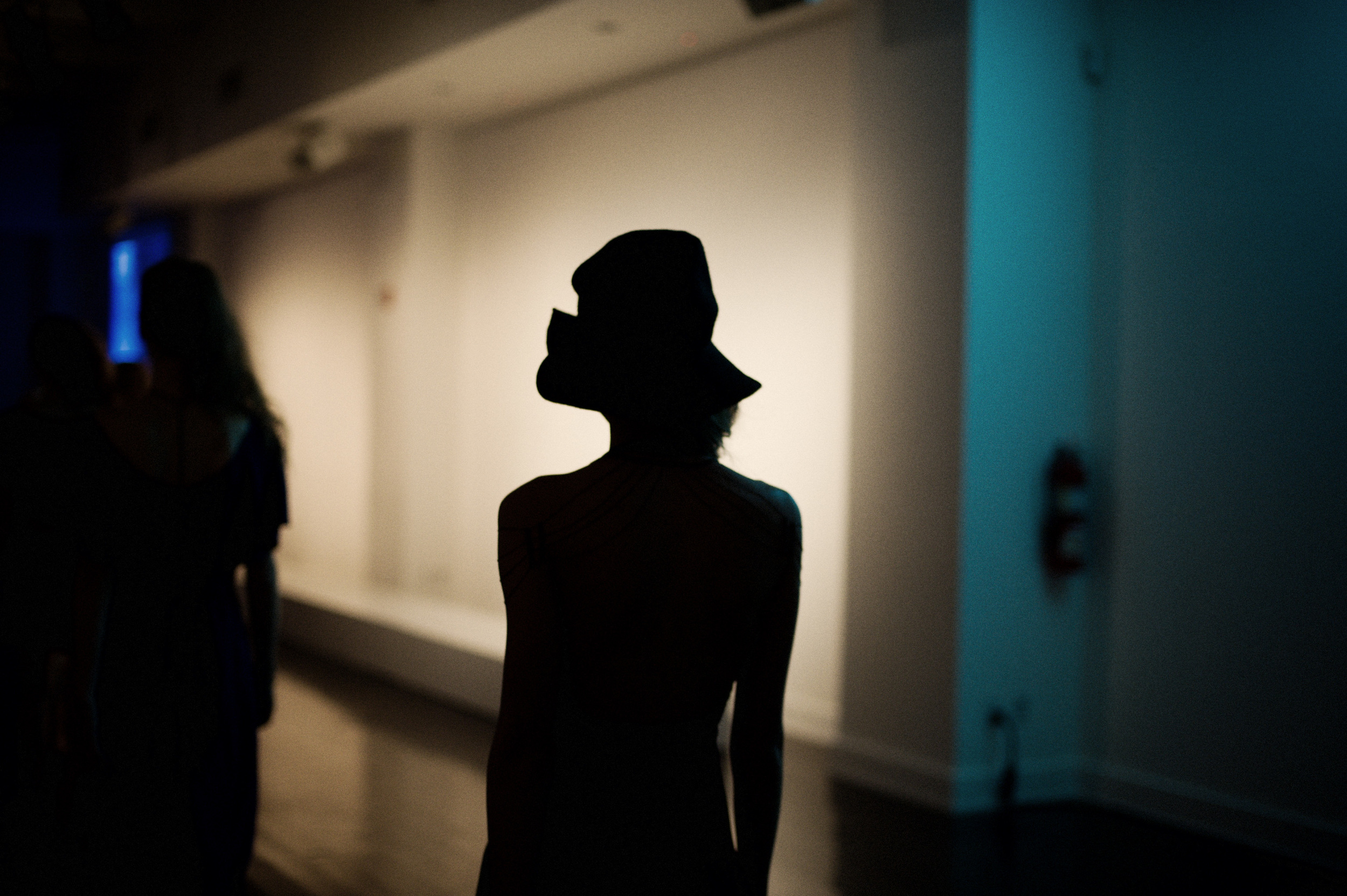 A model waits backstage at a fashion show. Photography by: Shawn Brackbill.