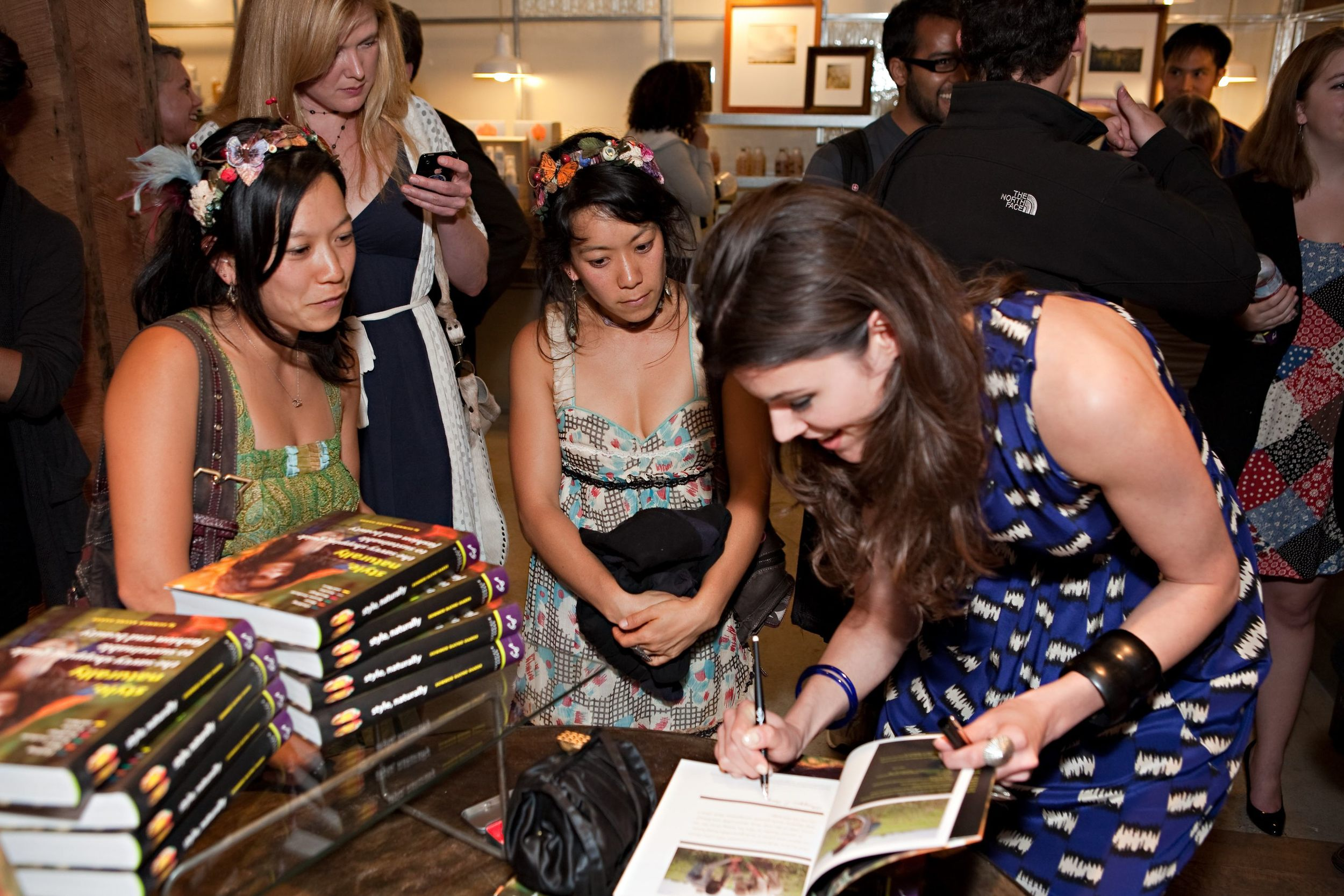 "You cannot help but develop the ""bent-over-back"" look when book signing. SF book signing at Jurlique."