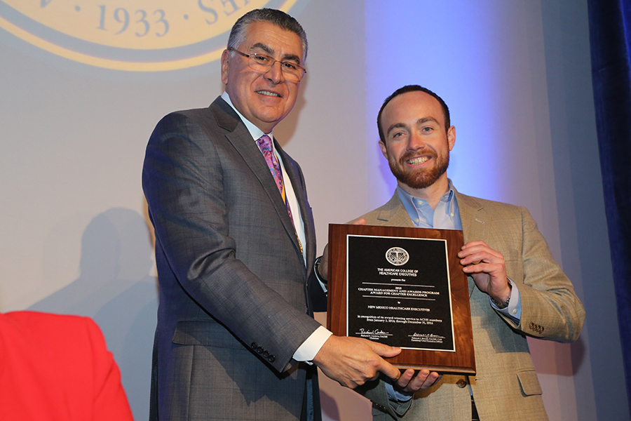 NMHE Immediate Past President Matthew Klosterman accepting the chapter's ACHE 2015 Award for Chapter Excellence from ACHE Chairman, Richard Cordova.