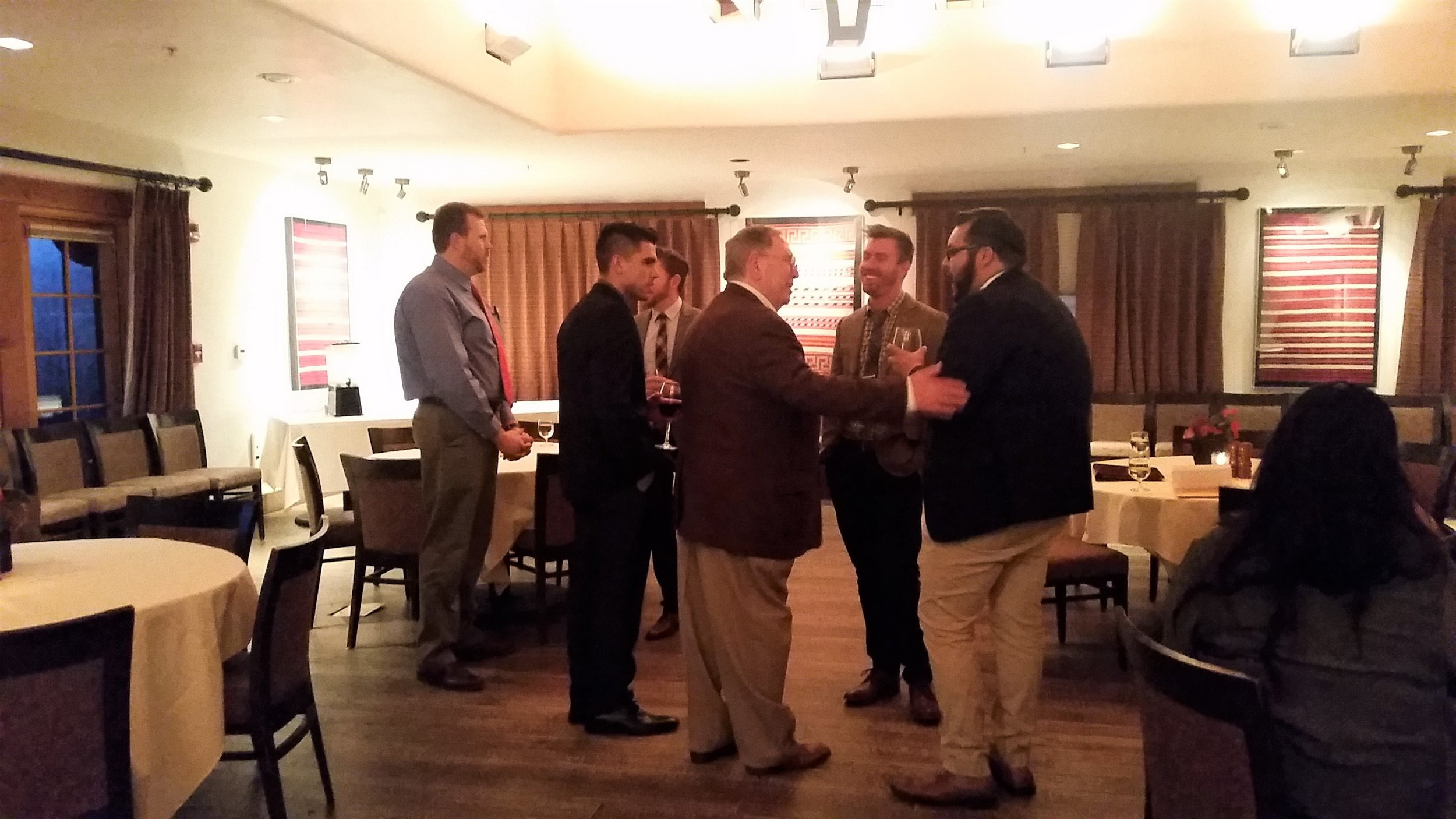 Above : Adjunct Professor, Ron Aldrich meeting with students and alum of the MHA program of UNM