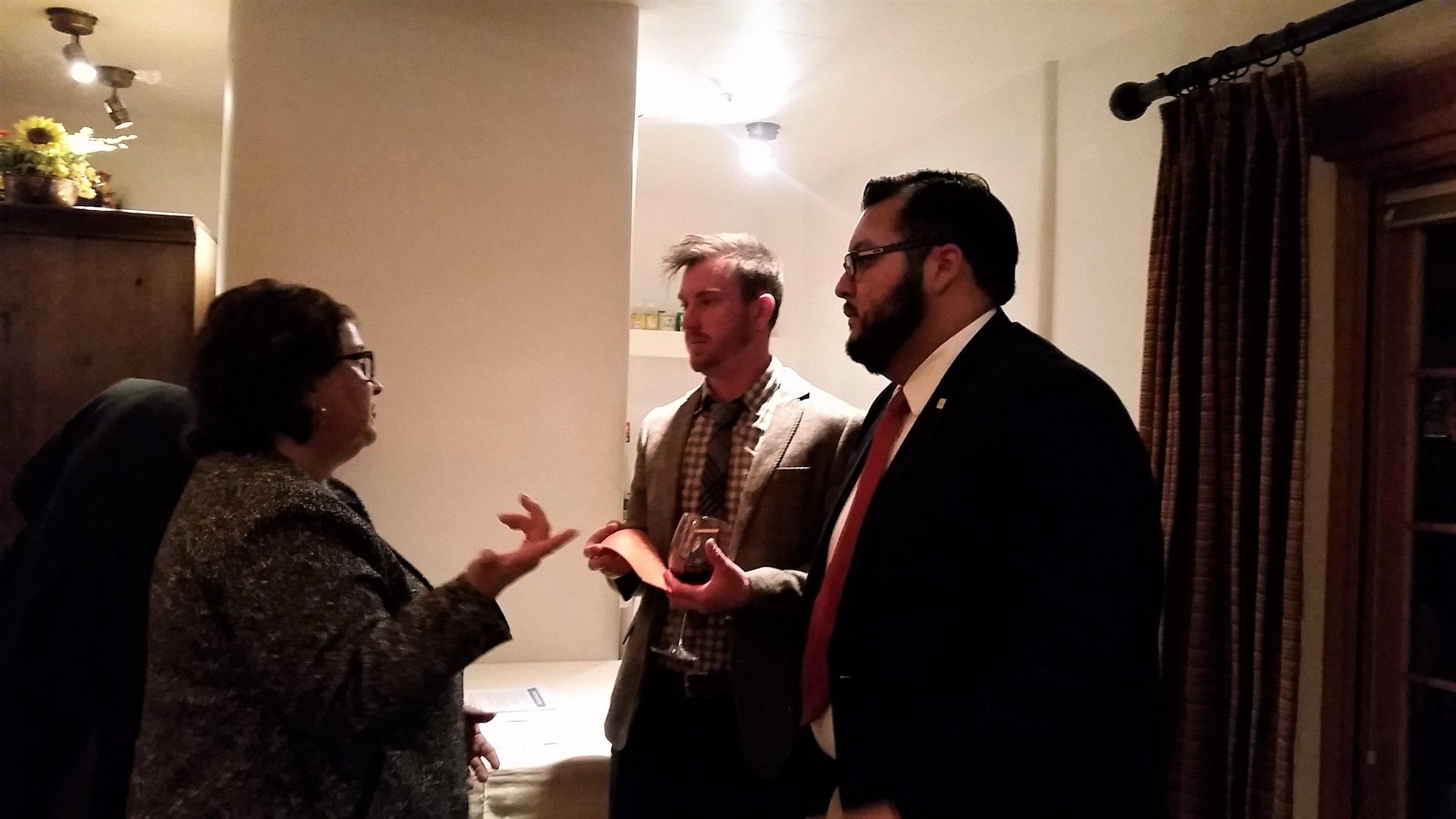 Above : Former Health Secretary under Governor Bill Richardson, Patricia Montoya talking with students in the MHA program, Stetson Berg and David Medrano