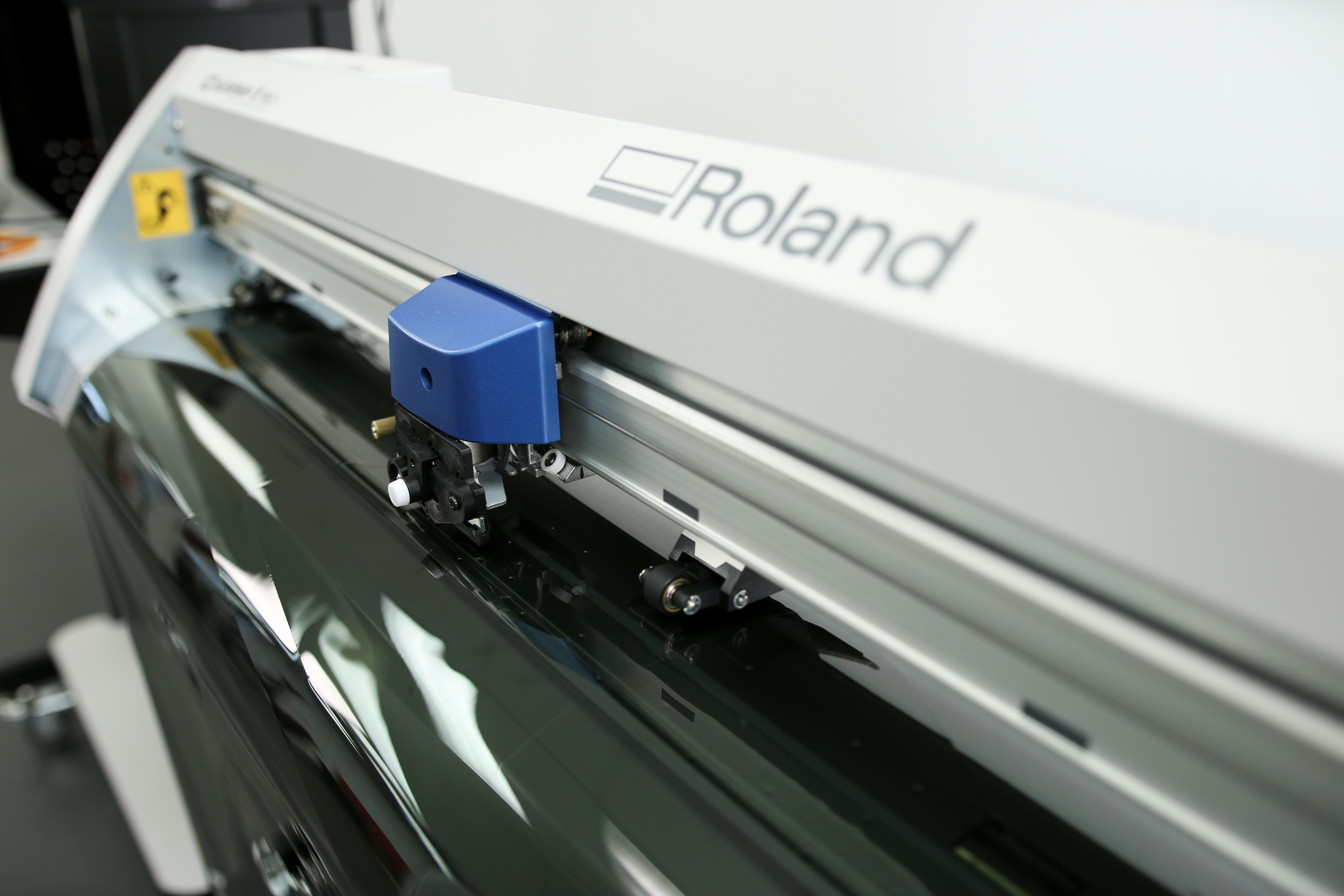 This is an example of the machine used to precision cut our LLumar window film. It is known as a 'plotter'.
