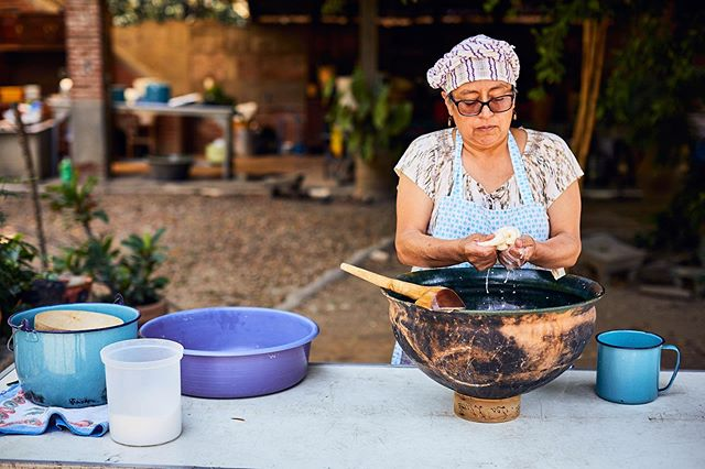 Andrea working Quesillo in her courtyard