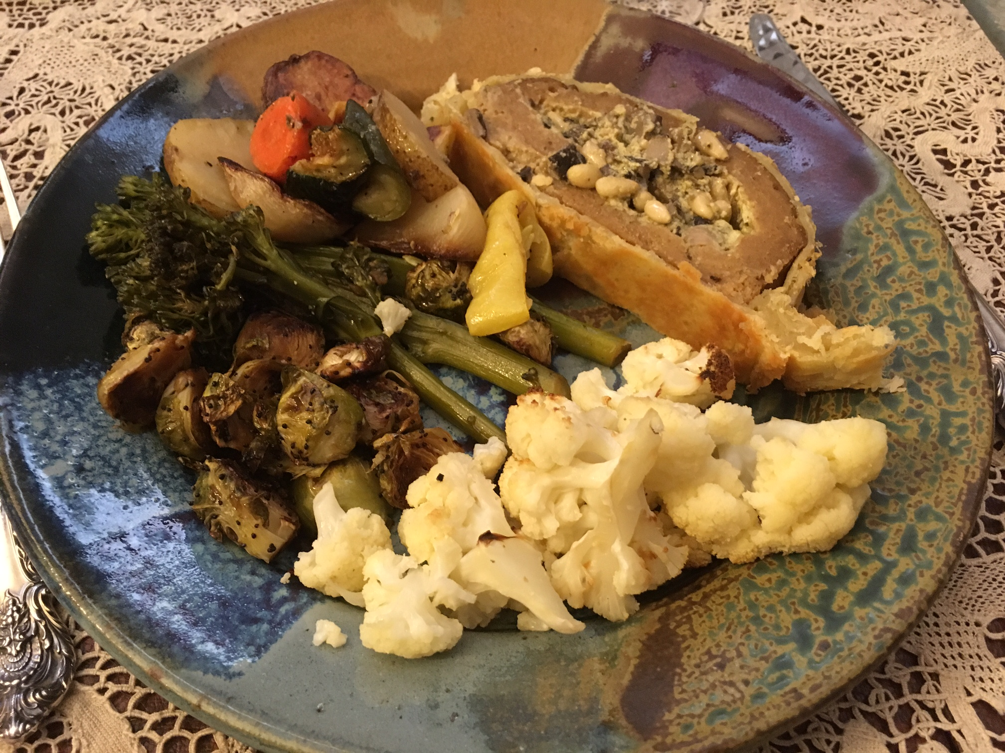Stuffed seitan roast en croute with roasted veggies, broccolini, Brussel sprouts, and cauliflower