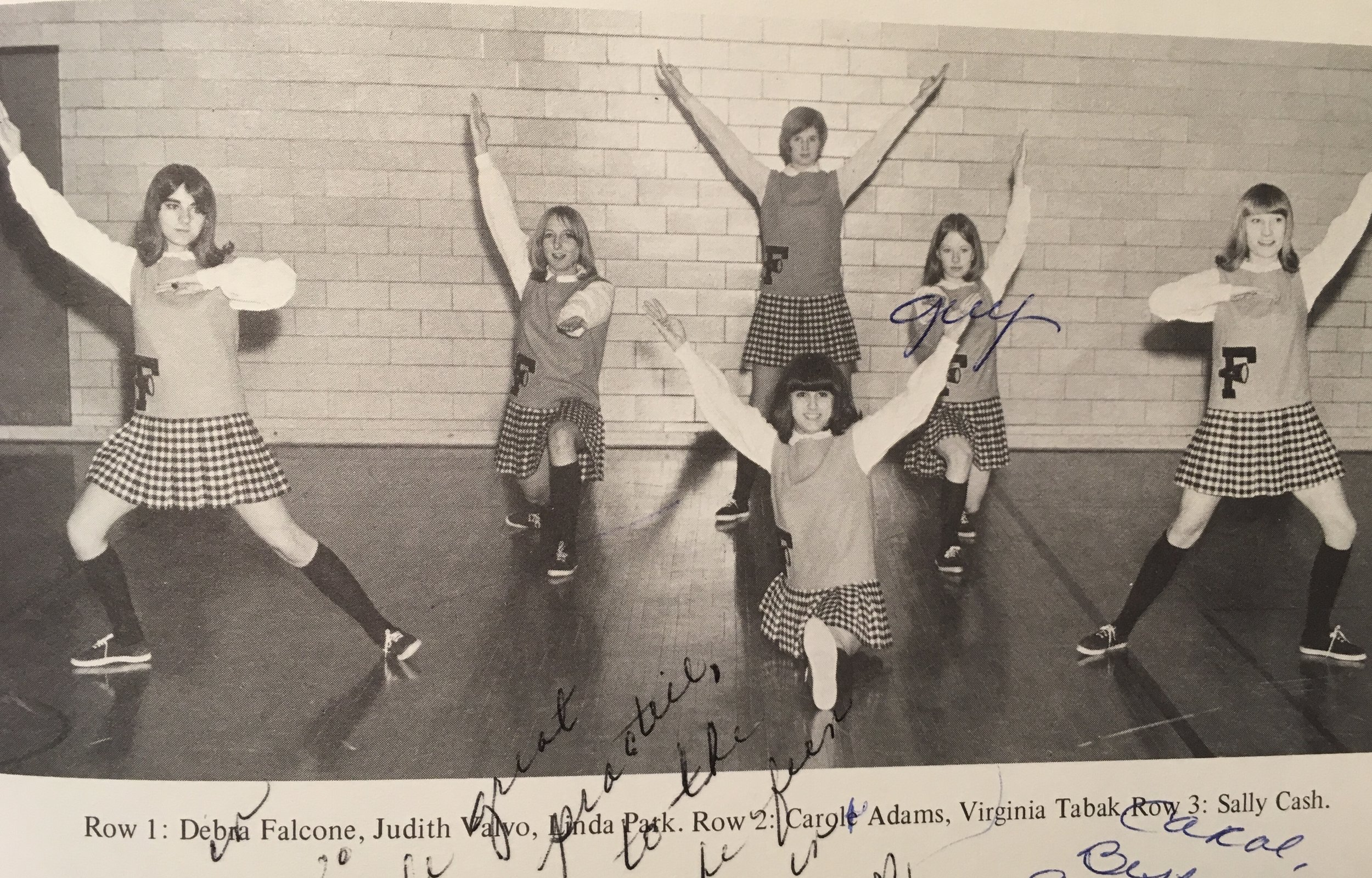 Yes I was a cheerleader. Cheerleading was one of the few athletic options for girls before Title IX. This was the longest our hair could be, truly!