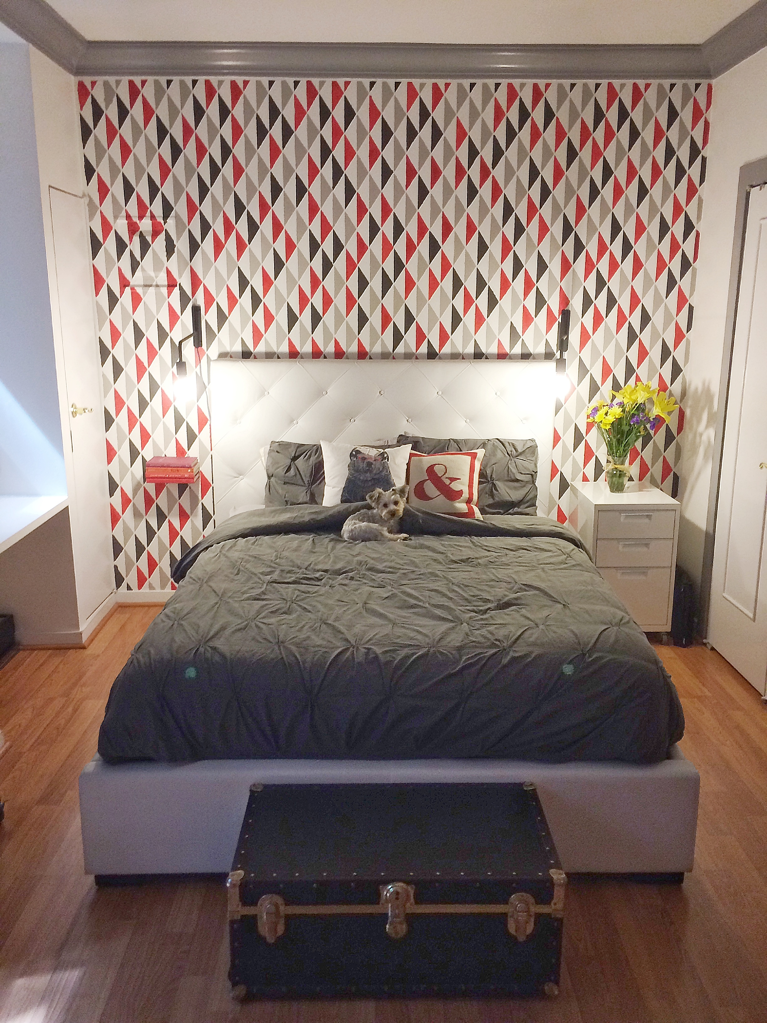 This project was a blast. We had a studio apartment with a couple different nooks.  The stencil was placed behind the bed to give a real pop and definition of space. The triangle pattern was playful and enhanced the existing vibe of the apartment.