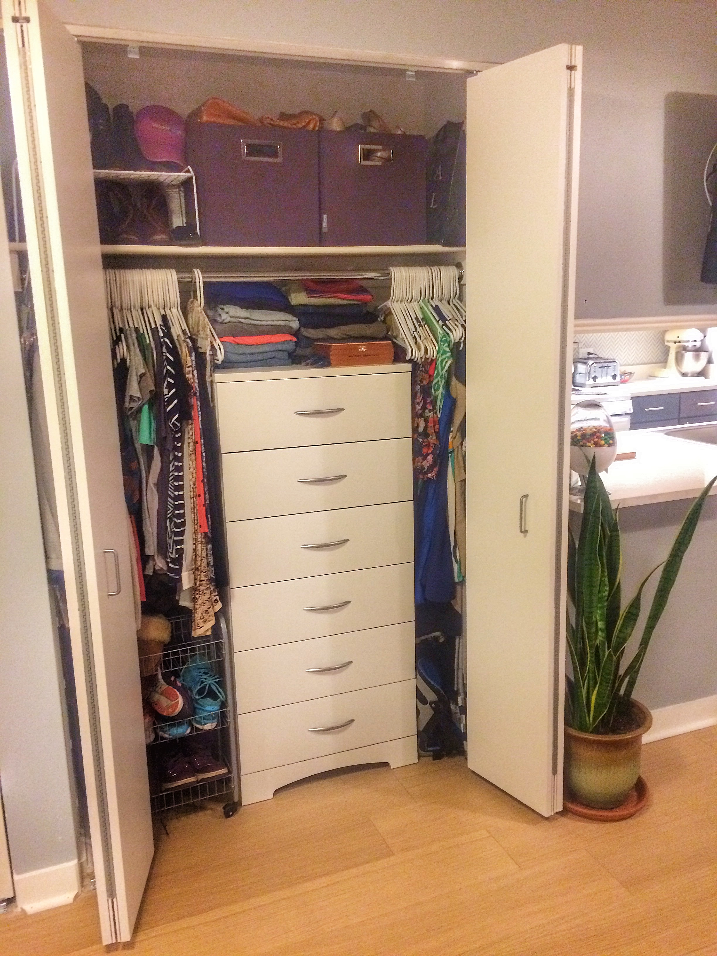 His and hers closets are highly organized for personal space and storage.