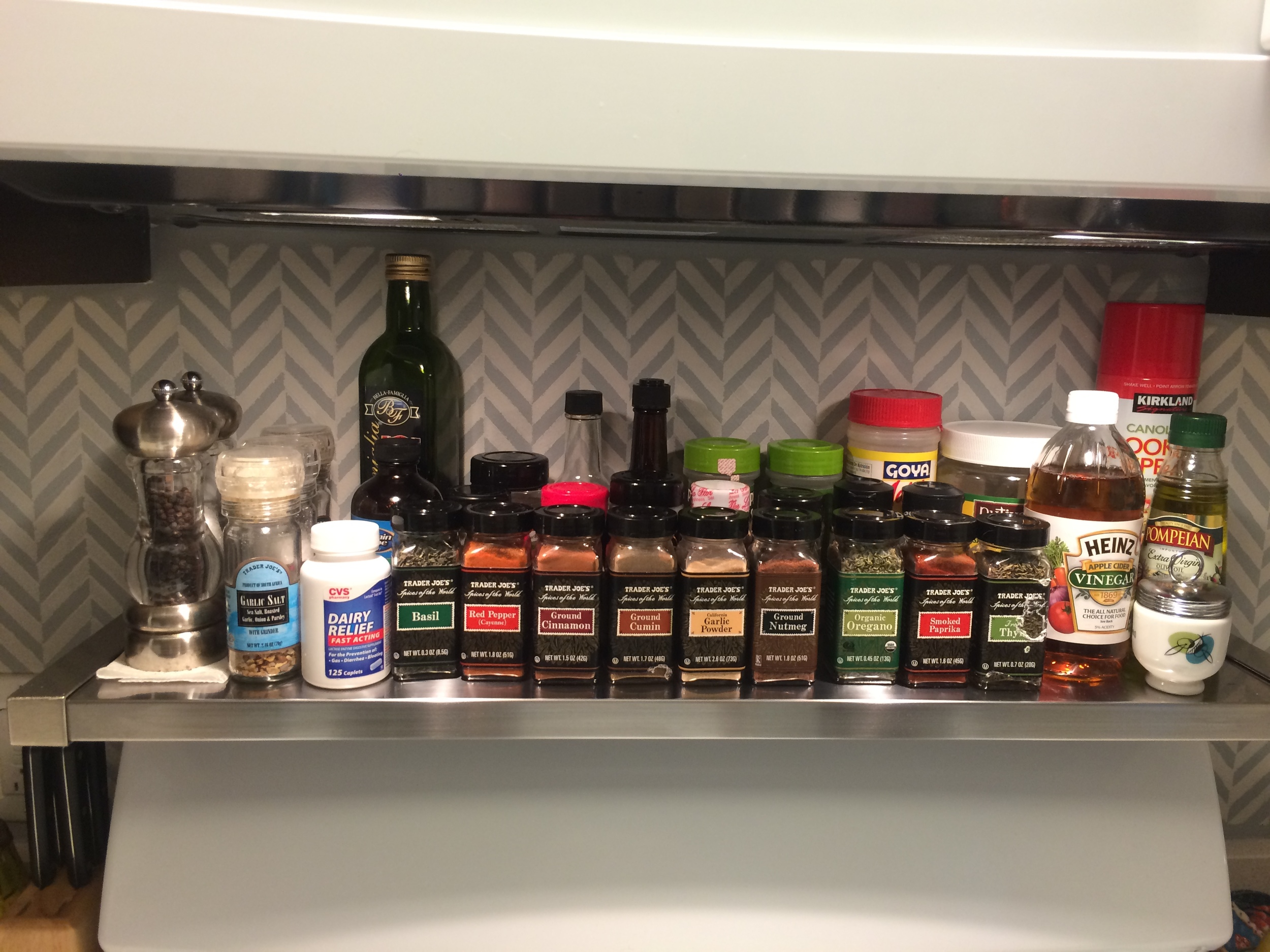 This metal shelf is a perfect fit to have easy access to spices while cooking. It also frees up space in the existing cabinets as well.