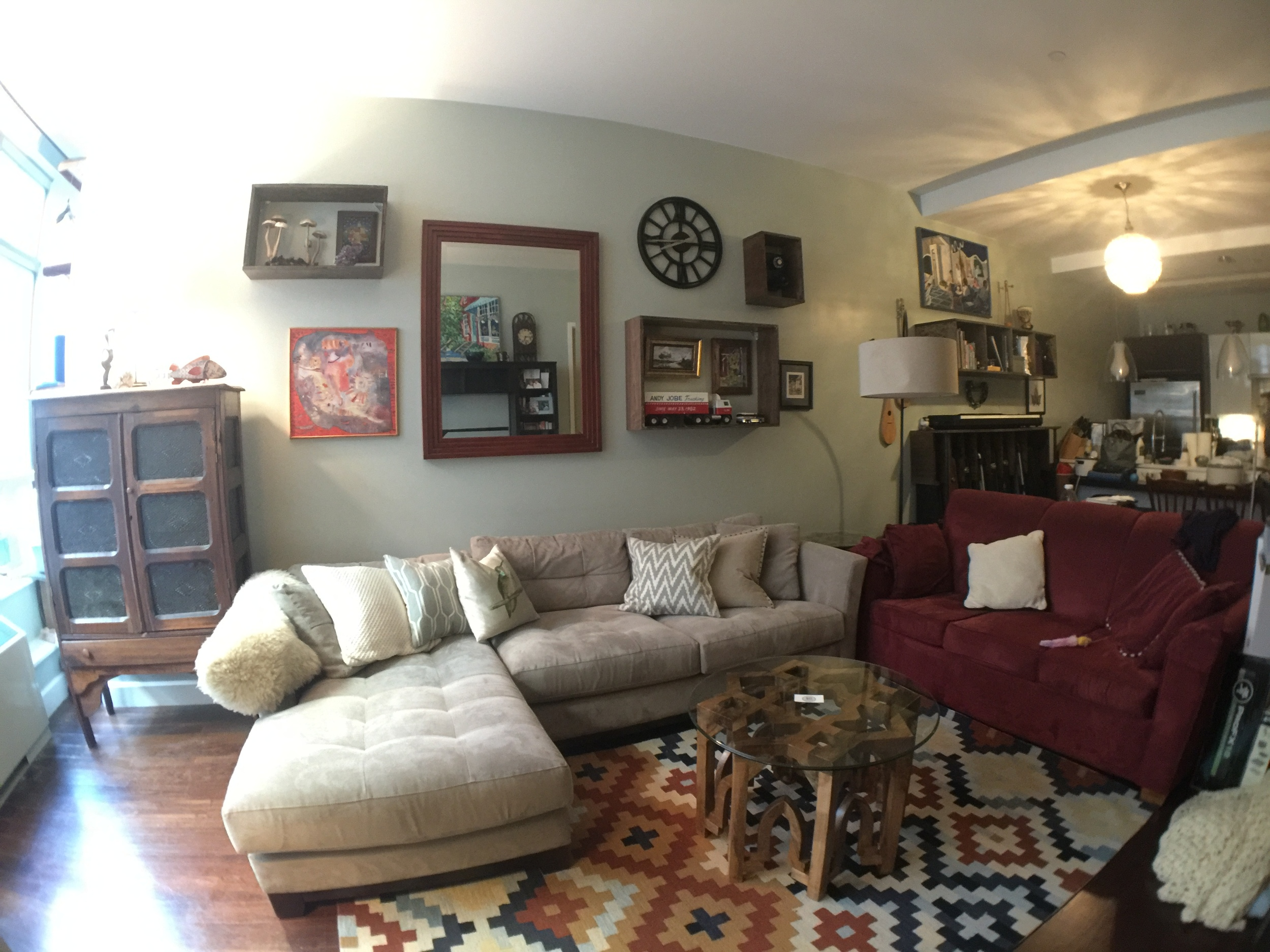 Shadow box shelving was added to this gallery wall to display the clients most prized possessions. Below is a video of us putting it together. Mixing the shelves and art created a fun eclectic look while using the height of the ceilings to their fullest potential.