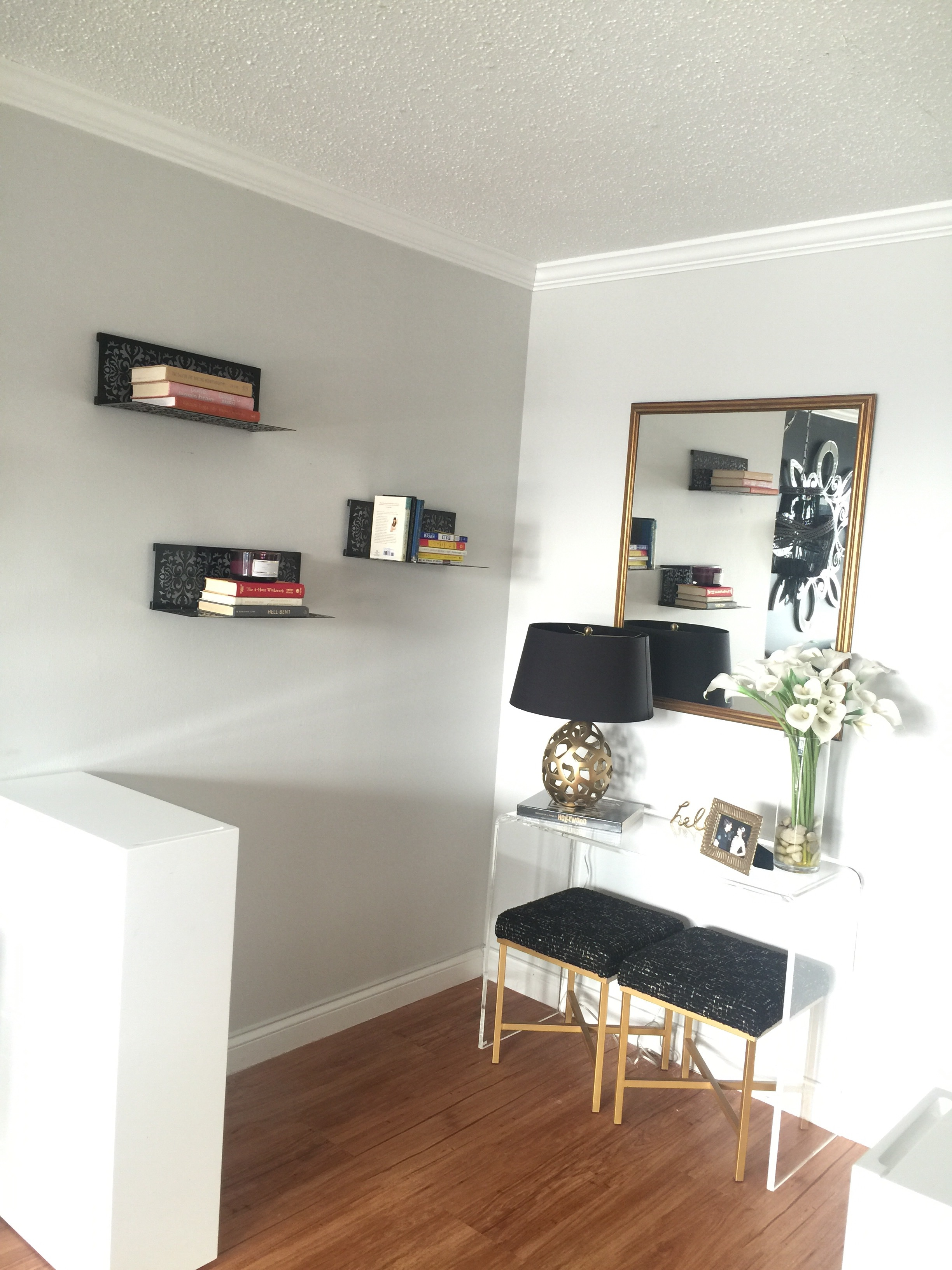 Black Metal floating shelves create interest with the rest of the decor in this entry way.