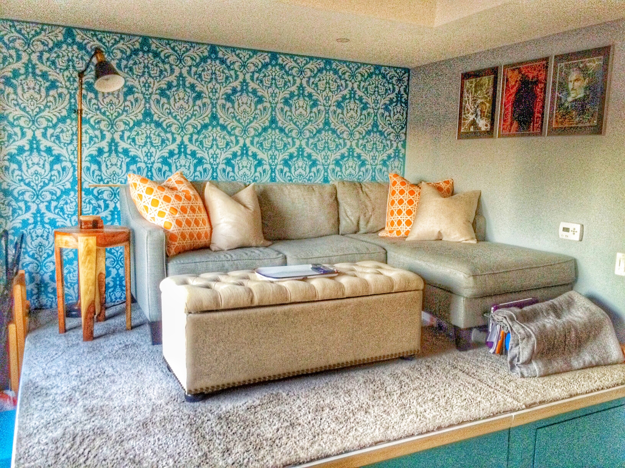 Teal accent wall with damask stencil in gray