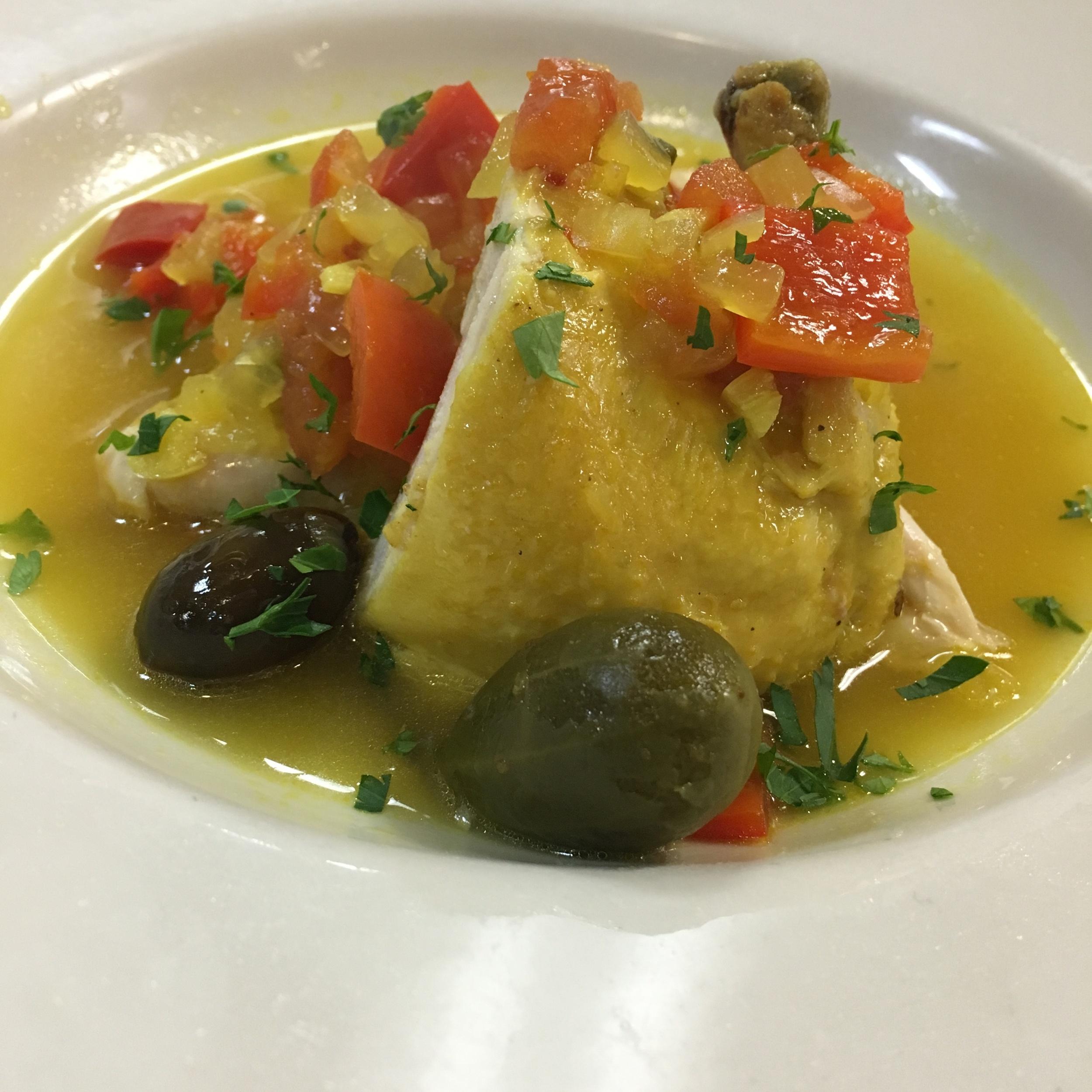 THIS DISH HAD CAPERS, GARLIC, OLIVES, BELL PEPPER, CAPER BERRIES AND TOMATOES....ALL CLASSIC ITALIAN FLAVORS.