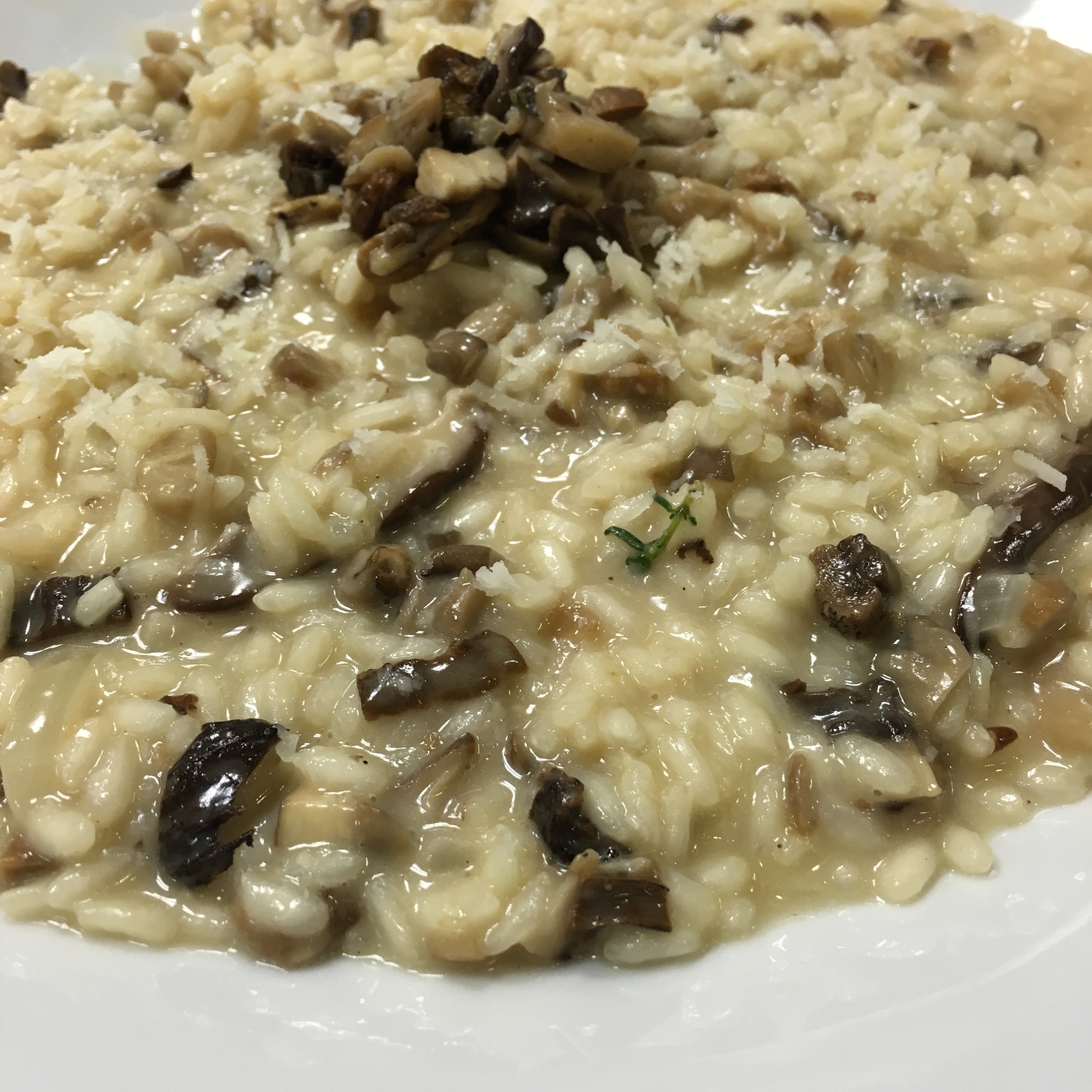 """RISOTTO IS SOMETHING THAT I LOVE YET NEVER TRIED TO MAKE. MAYBE BECAUSE I HAVE BEEN INTIMIDATED BY IT'S REPUTATION AS BEING """"DIFFICULT"""" TO MAKE. I MADE MINE TO THE CONSISTENCY ITALIANS CALL ALL'ONDA, WHICH TRANSLATES TO """"WITH WAVES"""". IT IS CREAMIER THAN THE AMERICAN STYLE, WHICH IS USUALLY """"MOUNDED"""" ON THE PLATE."""