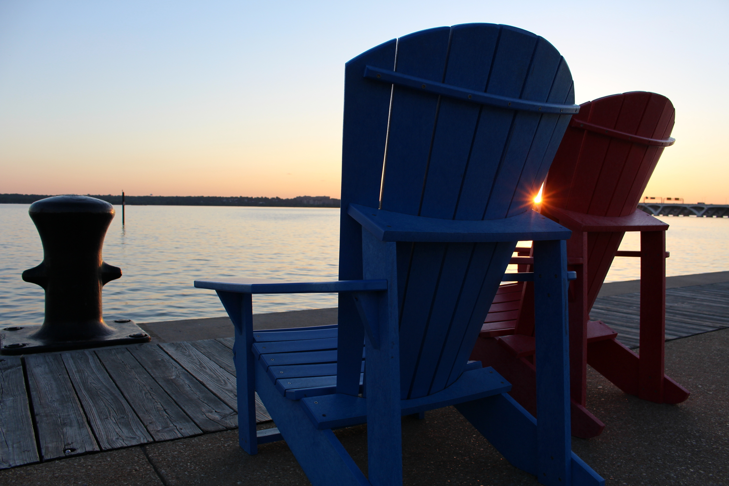 And forget reaching across the aisle, a sunset at National Harbor brings blue and red so close together only a sunburst can fit between them.