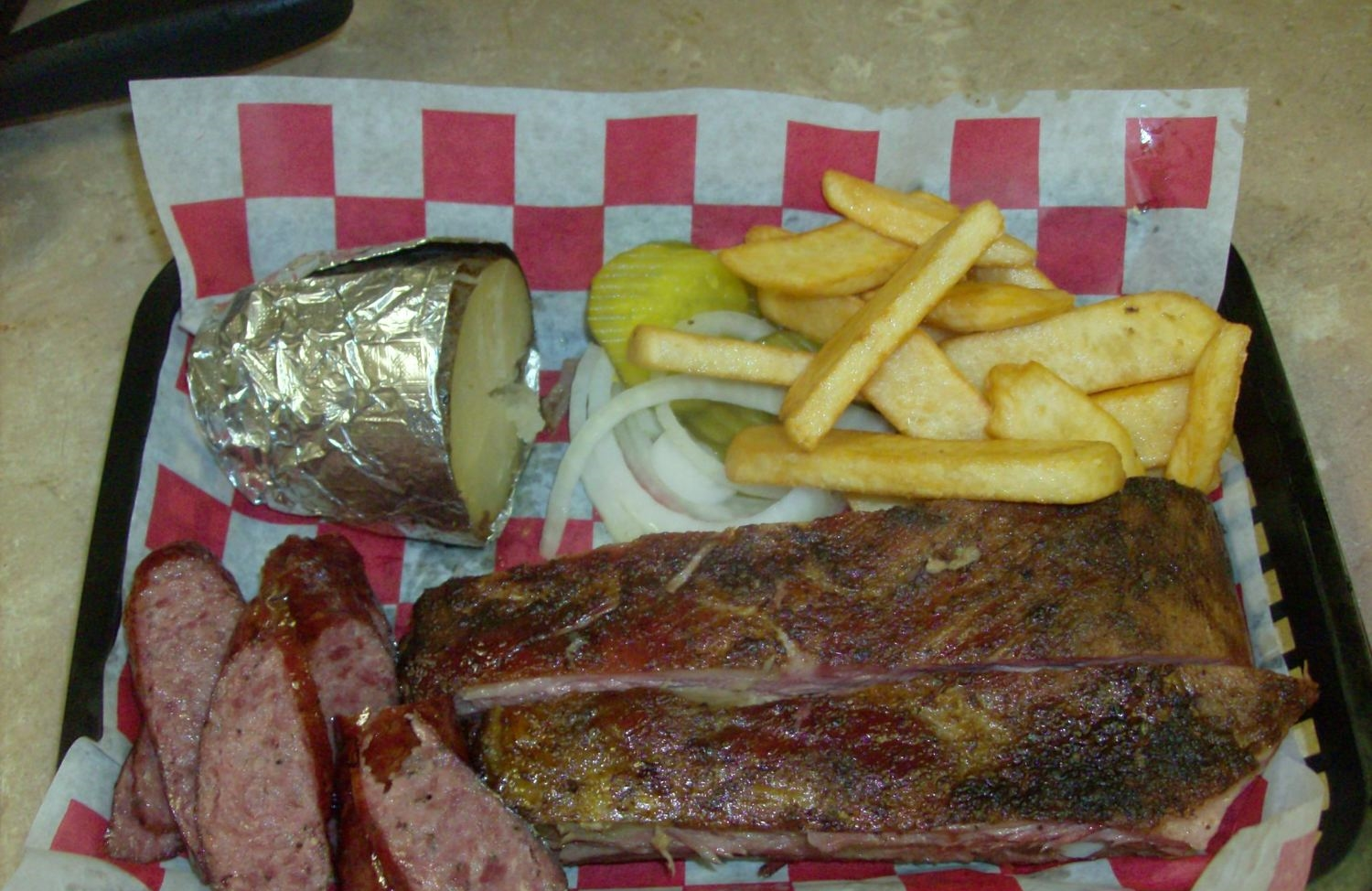 Bar-B-Que Plate (two meat: Ribs, sausage) with fries and baked potato