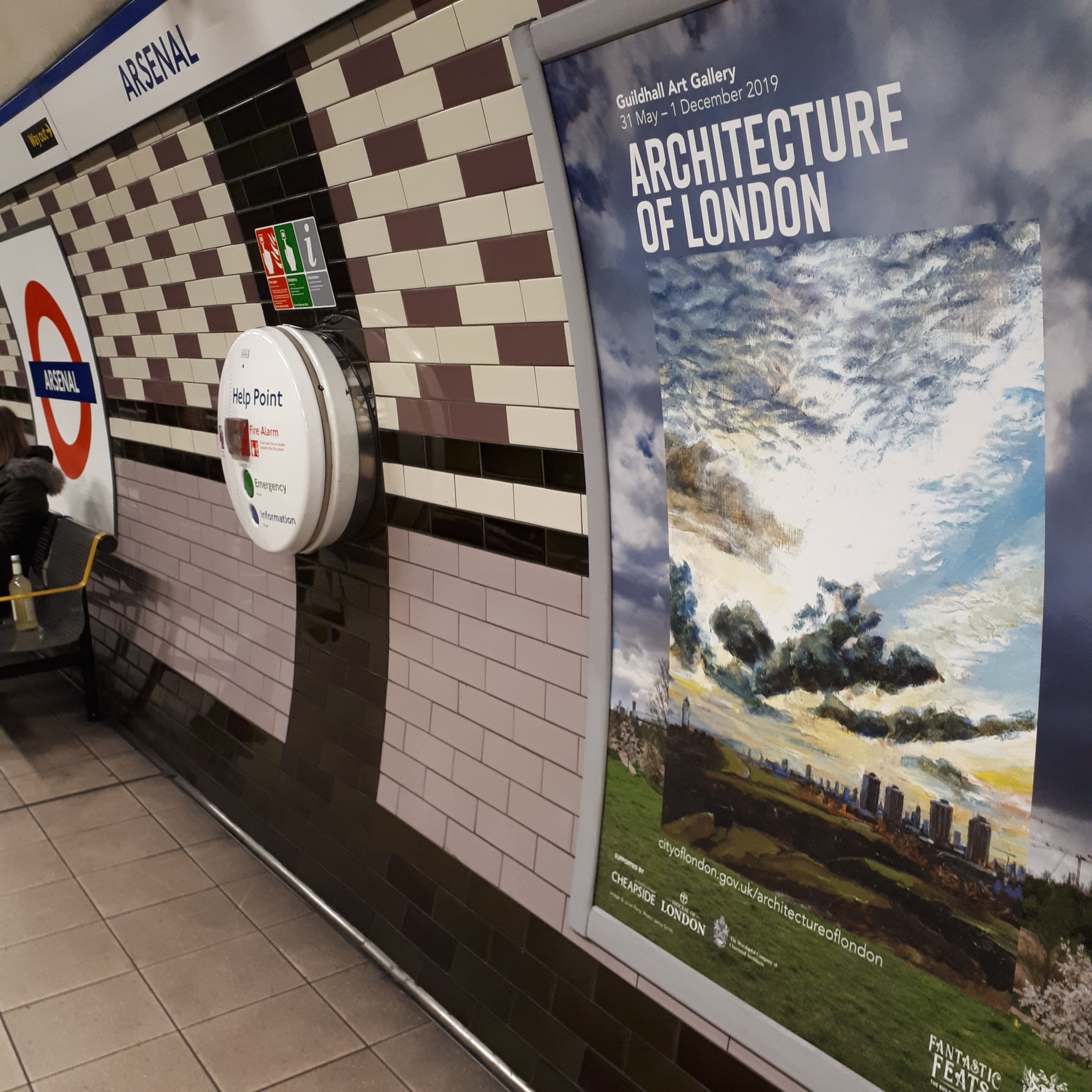 Architecture of London, London Underground poster at Arsenal Station featuring painting by Julian Perry.